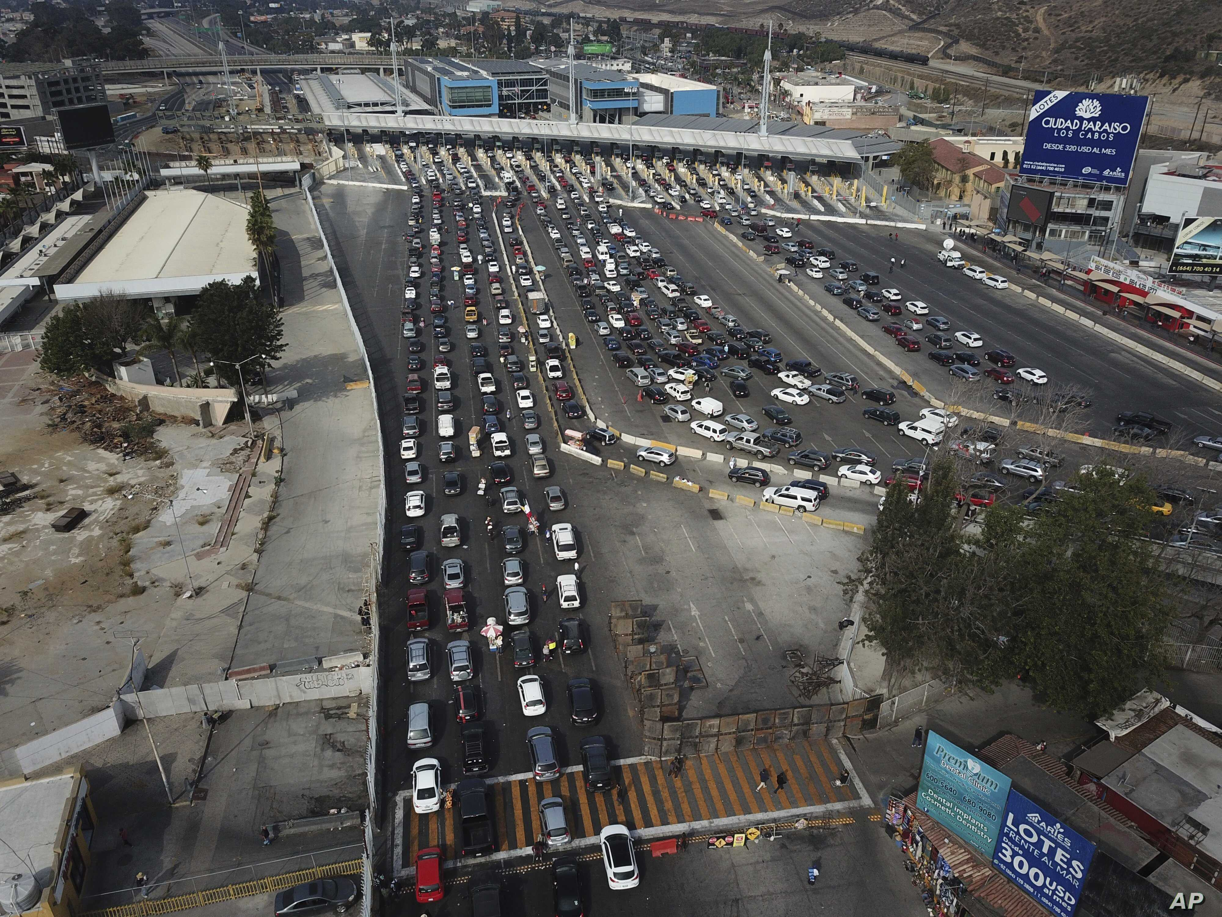 Drivers wait to cross the Mexico-U.S. border from Tijuana, Mexico, Nov. 19, 2018. The United States closed off northbound traffic for several hours at the busiest border crossing with Mexico to install new security barriers.
