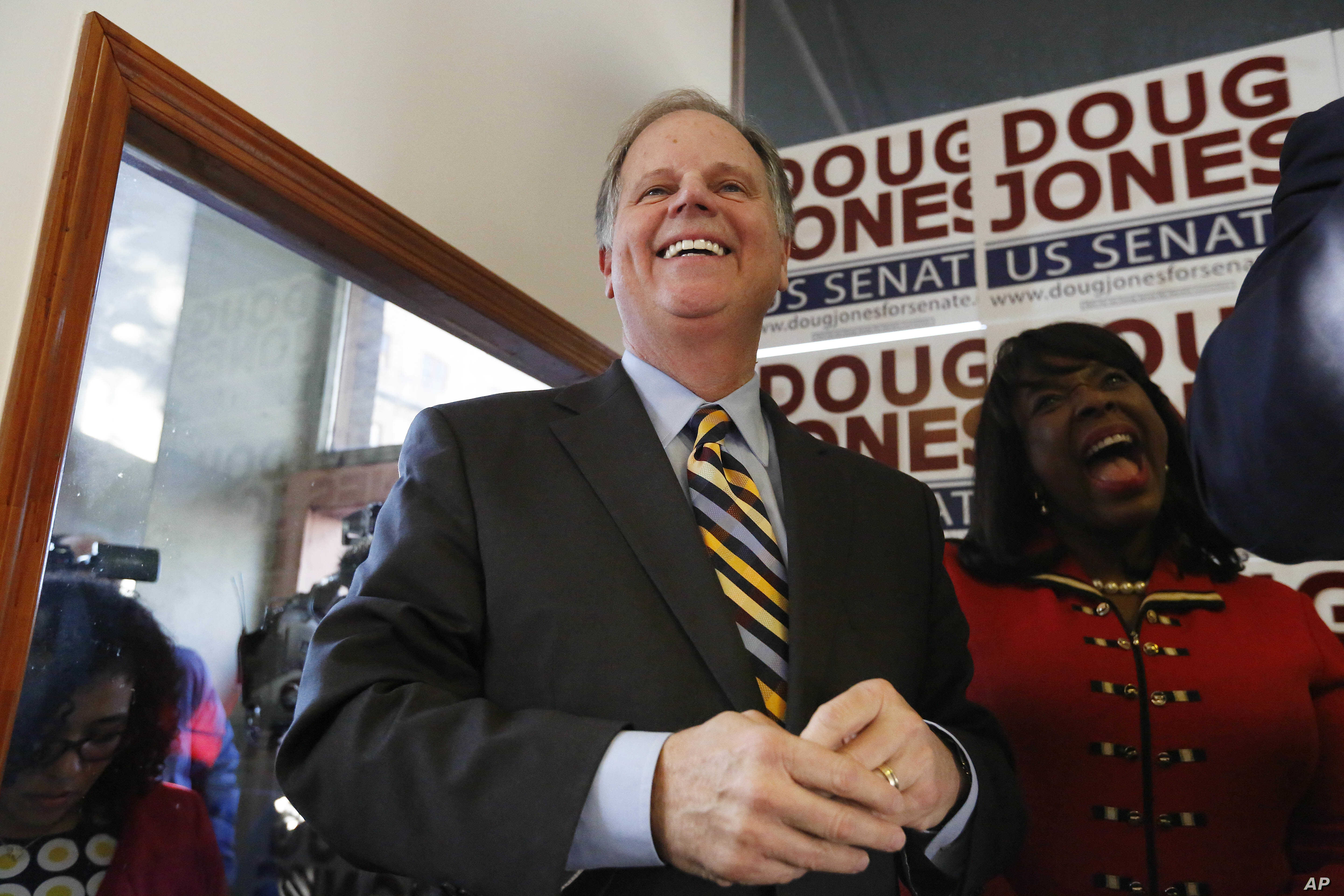 Democratic senatorial candidate Doug Jones speaks during a campaign rally Sunday, Dec. 10, 2017, in Birmingham, Alabama.