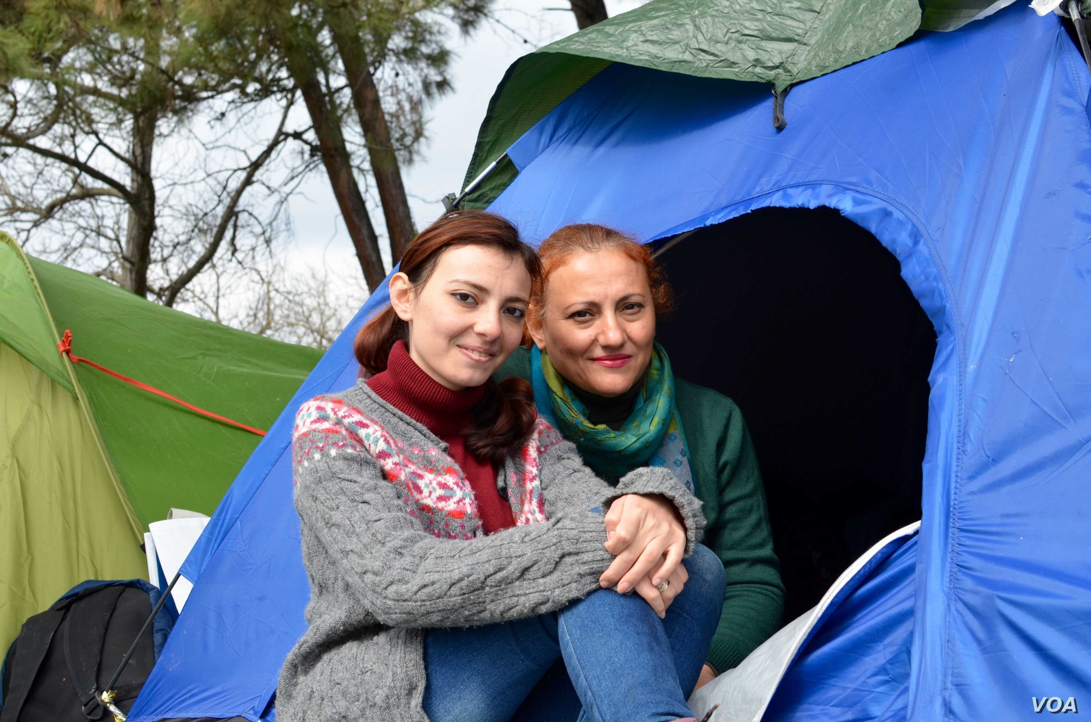 Ramia Sabbagh and her mother in front of their tent at the Idomeni camp, March 17, 2016. (Jamie Dettmer for VOA)