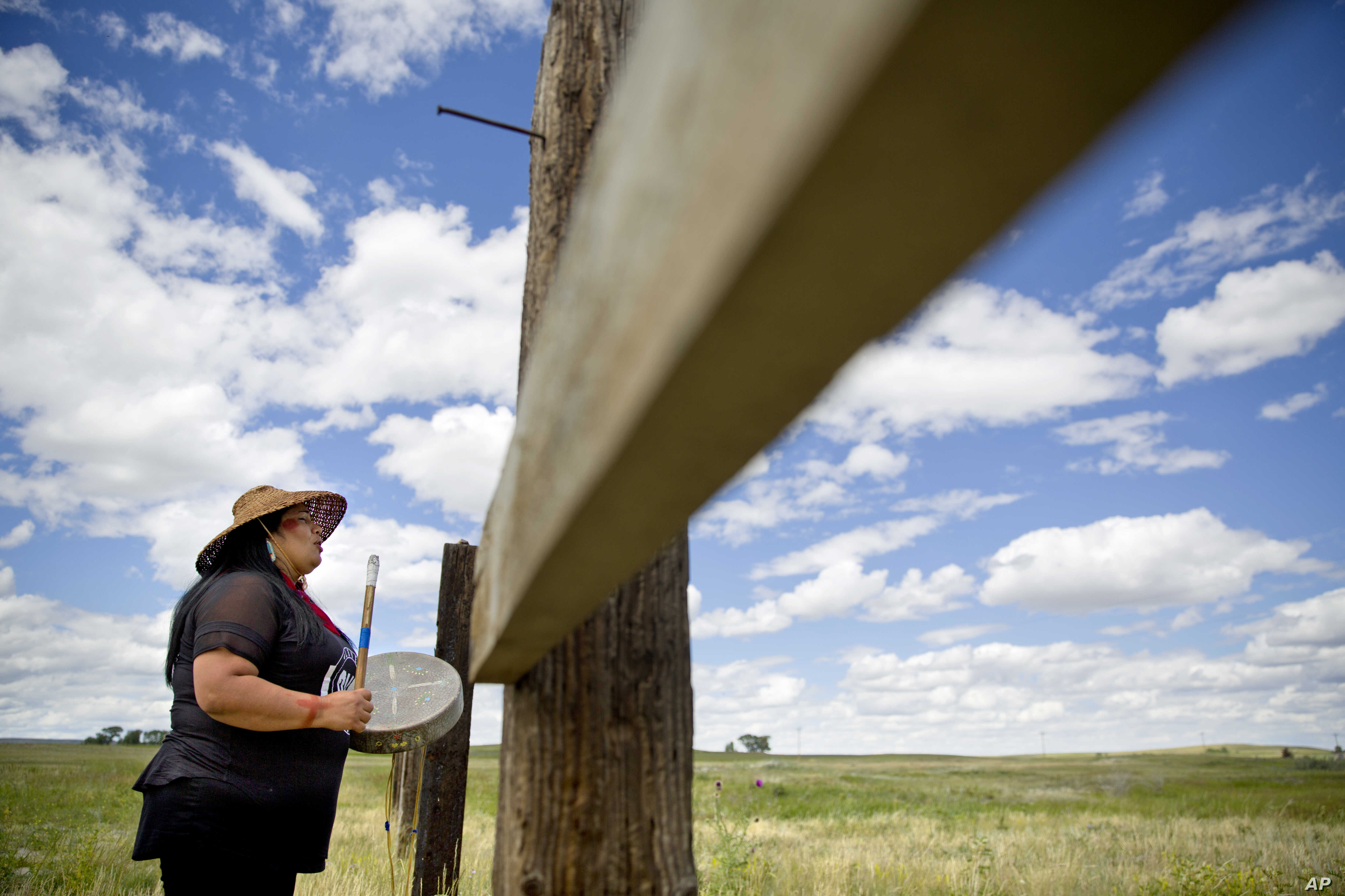 FILE - Roxanne White, whose aunt was murdered in 1996, sings and drums a women's warrior and honor song created for missing and murdered indigenous women, before joining a search in Valier, Mont., for Ashley HeavyRunner Loring, who disappeared last y...