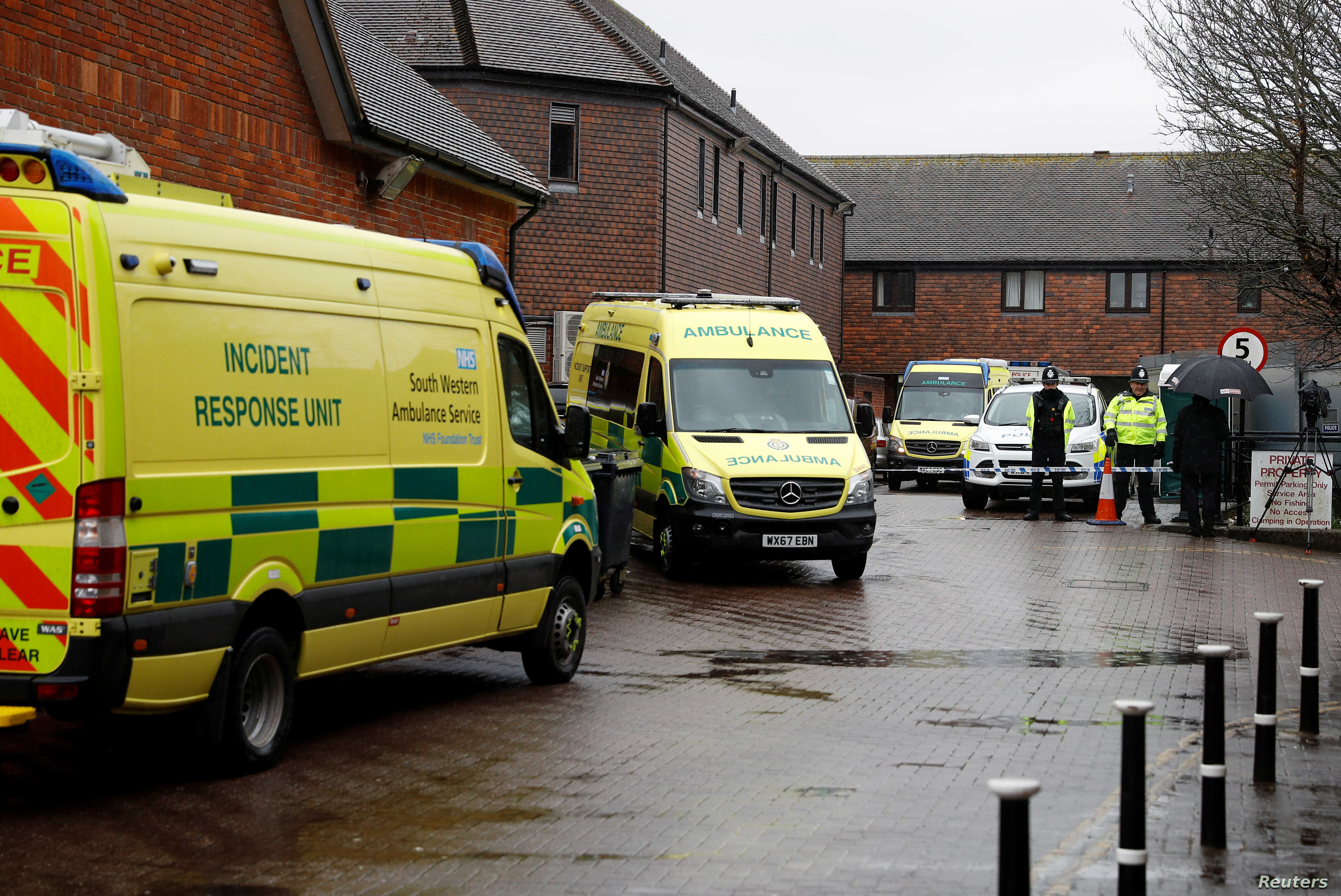 Emergency services vehicles are parked behind a pub that was visited by former Russian intelligence officer Sergei Skripal and his daughter Yulia before they found poisoned; and which remains closed; in Salisbury, Britain, March 28, 2018.