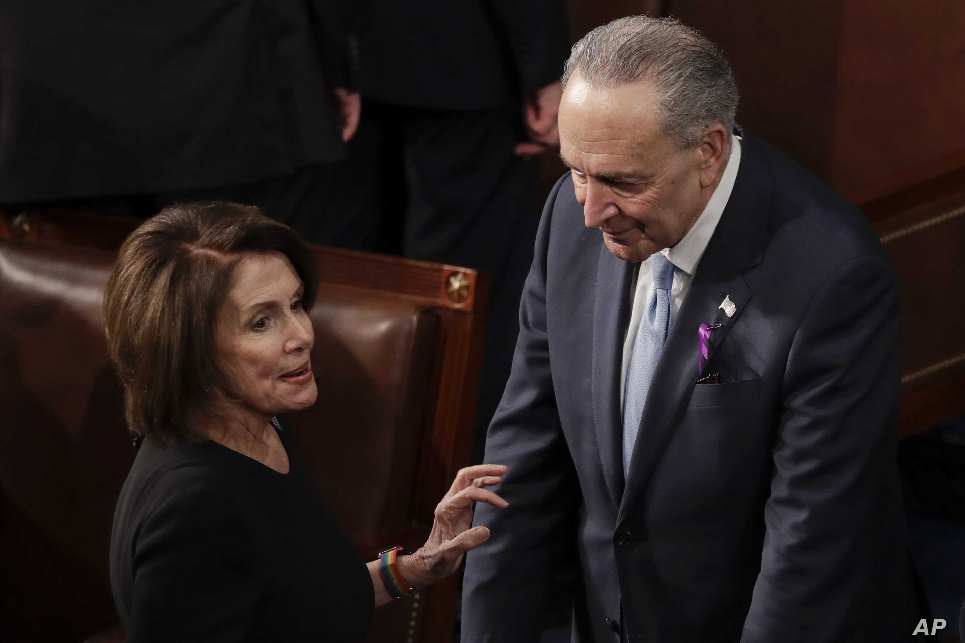 House Minority Leader Nancy Pelosi of California talks with Senate Minority Chuck Schumer of New York before the State of the Union address to a joint session of Congress on Capitol Hill in Washington, Jan. 30, 2018.