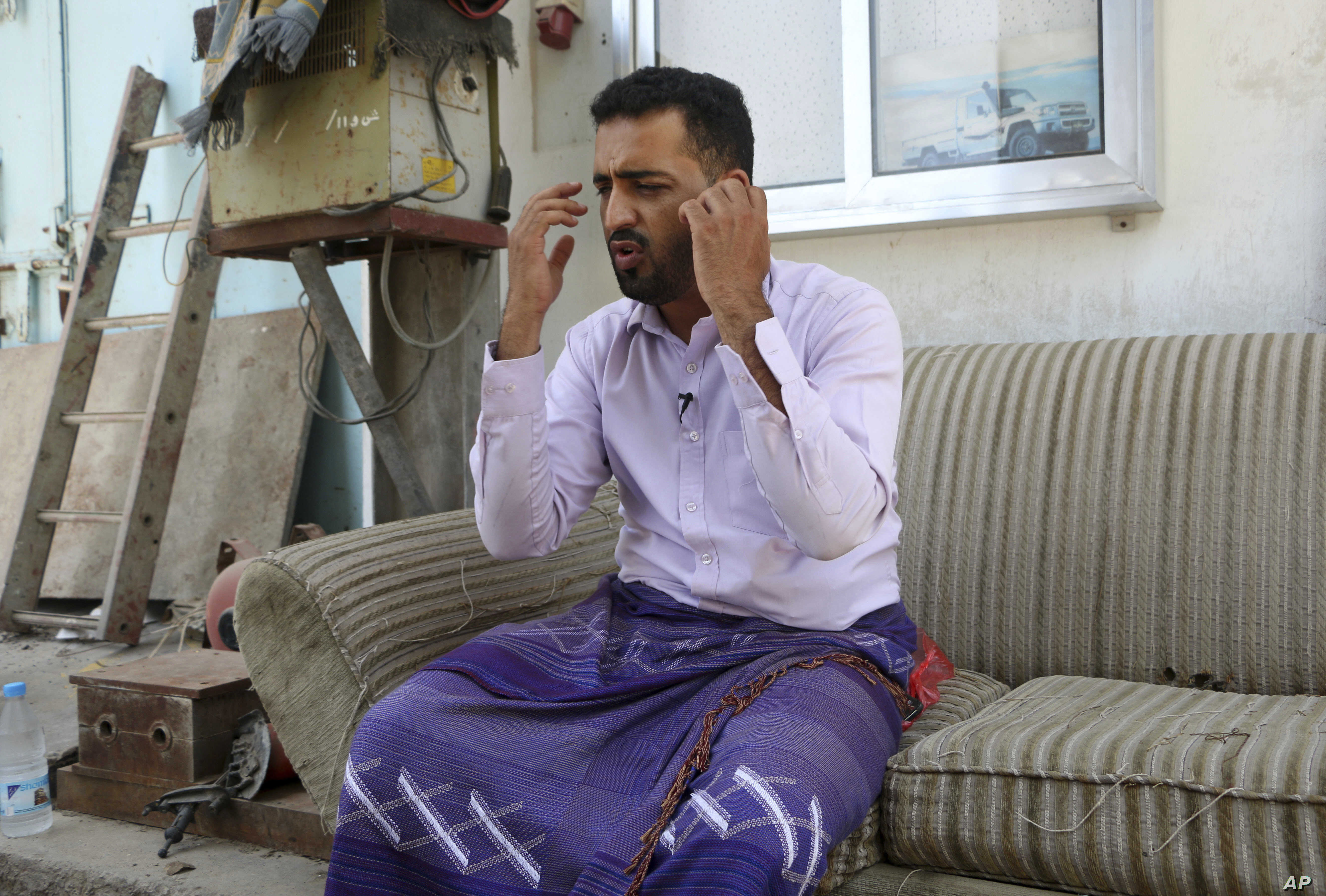 Yemeni businessman Ali Awad Habib recounts the torment he suffered in prison, where he said he was beaten with wires and wooden clubs and given electrical shocks, in this May 8, 2017, photo in Aden, Yemen. Habib was detained for weeks after Emirati-b...