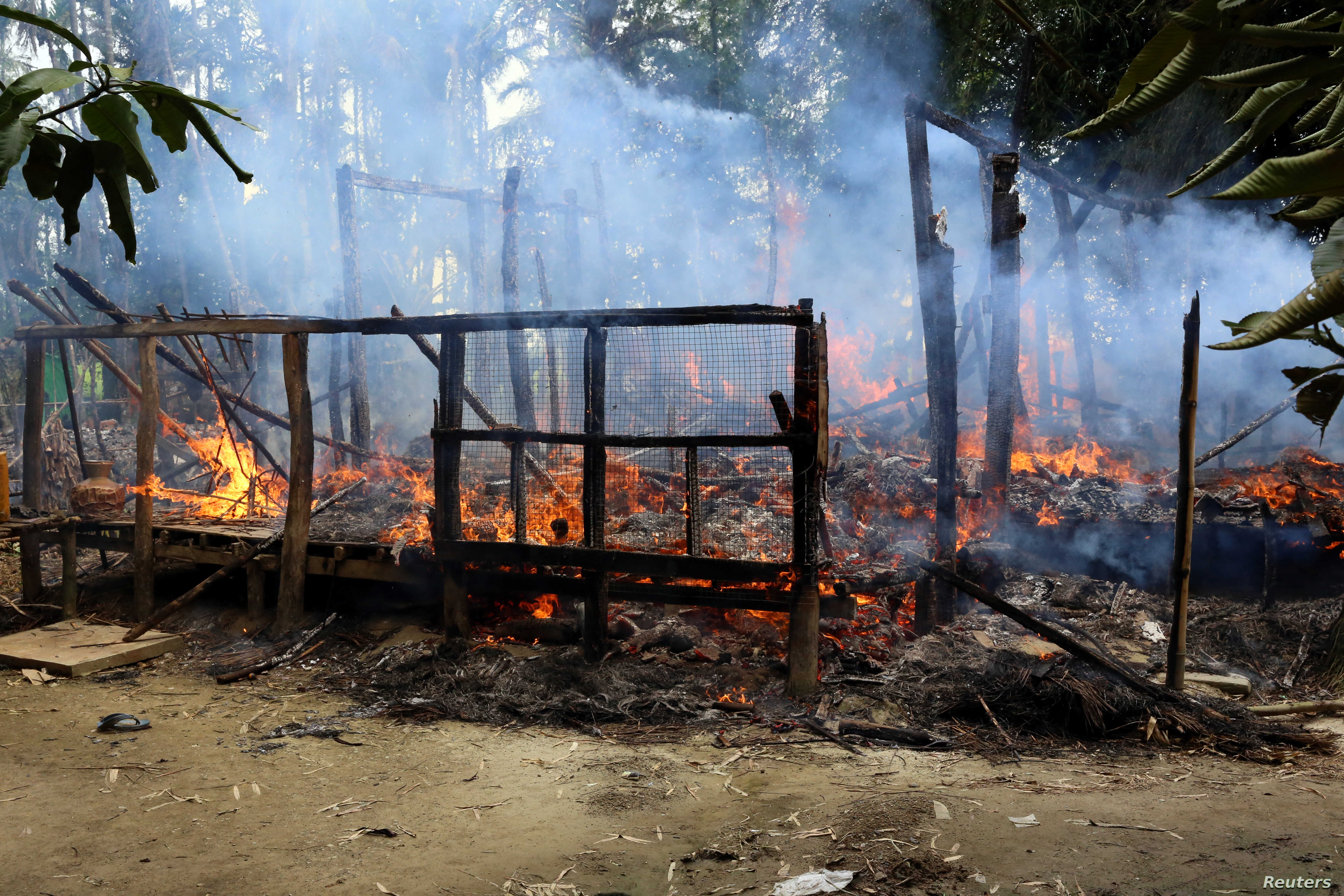 A house is seen on fire in Gawduthar village, Maungdaw township, in the north of Rakhine state, Myanmar, Sept. 7, 2017.