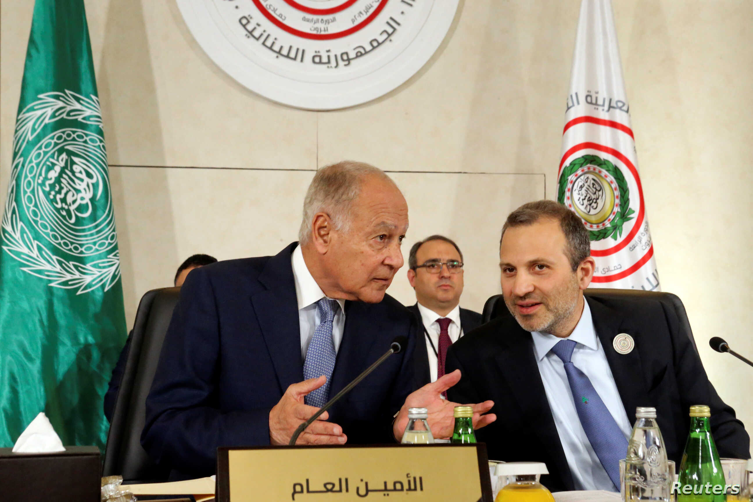 Arab League Secretary-General Ahmed Abul Gheit gestures as he talks with Lebanese Foreign Minister Gebran Bassil, at a pre Arab Economic and Social Development summit meeting in Beirut, Lebanon January 18, 2019.