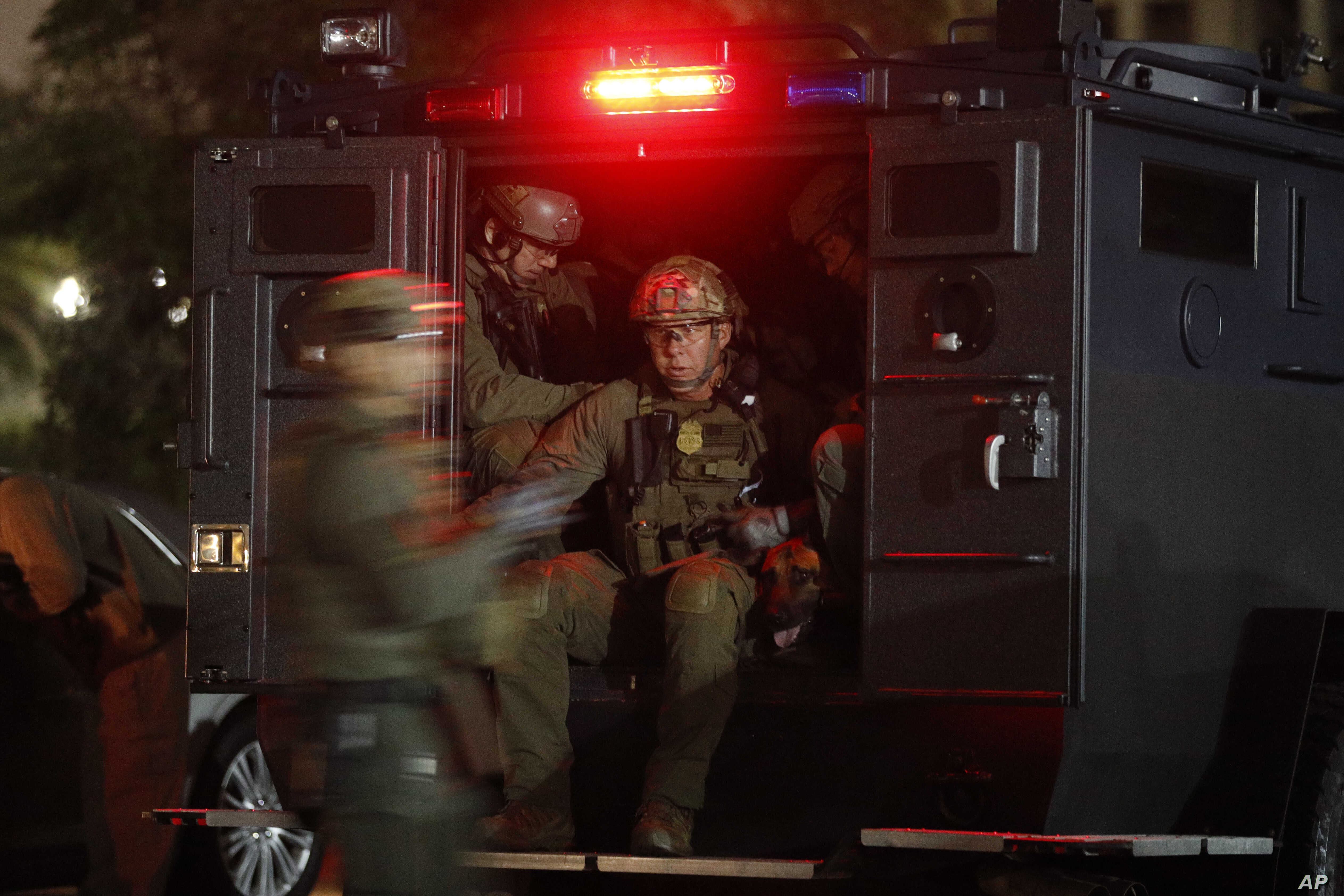 FILE - ATF agents board a truck to conduct an early morning raid against members and associates of the MS-13 gang, May 17, 2017, in Los Angeles, California.