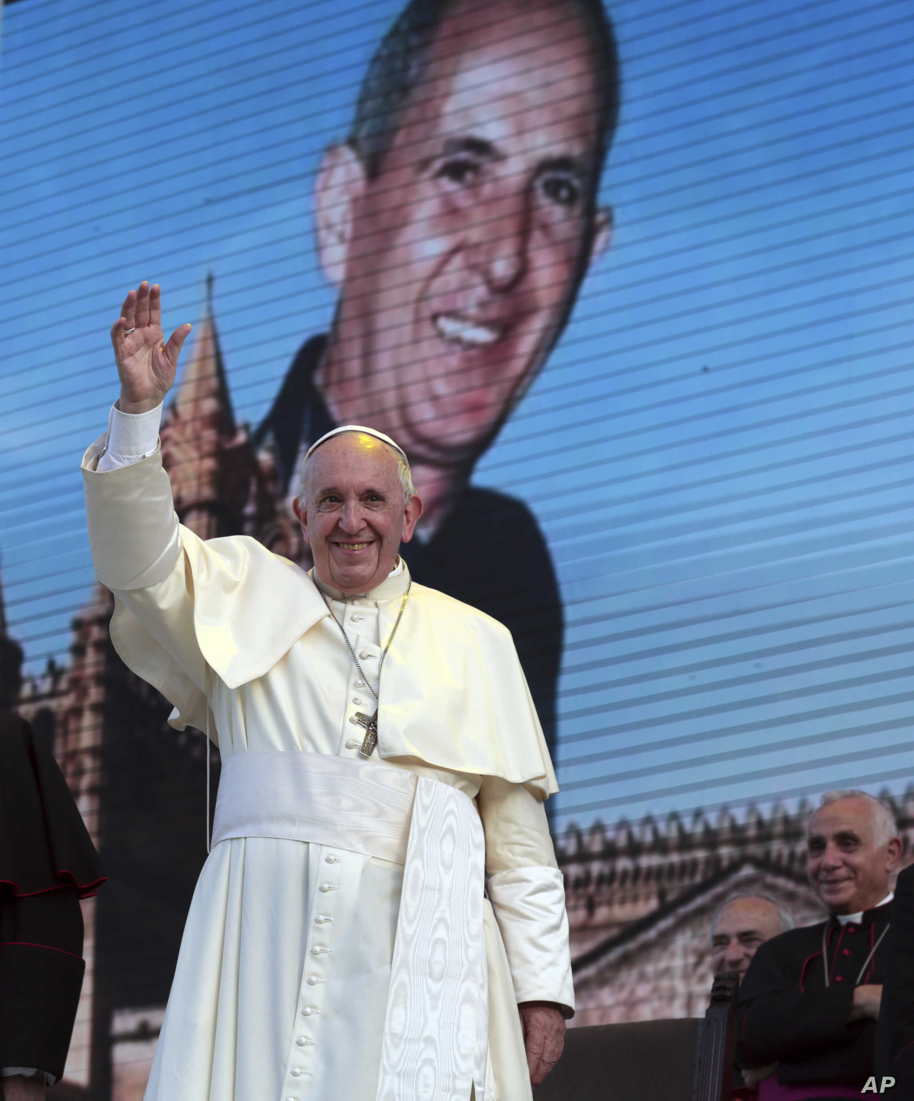 """Pope Francis waves as he leaves after a meeting with youths in Piazza Politeama, in Palermo, southern Italy, Sept. 15, 2018. The pontiff was paying tribute in Sicily to a priest, the Rev. Giuseppe """"Pino"""" Puglisi, who worked to keep youths away from t..."""