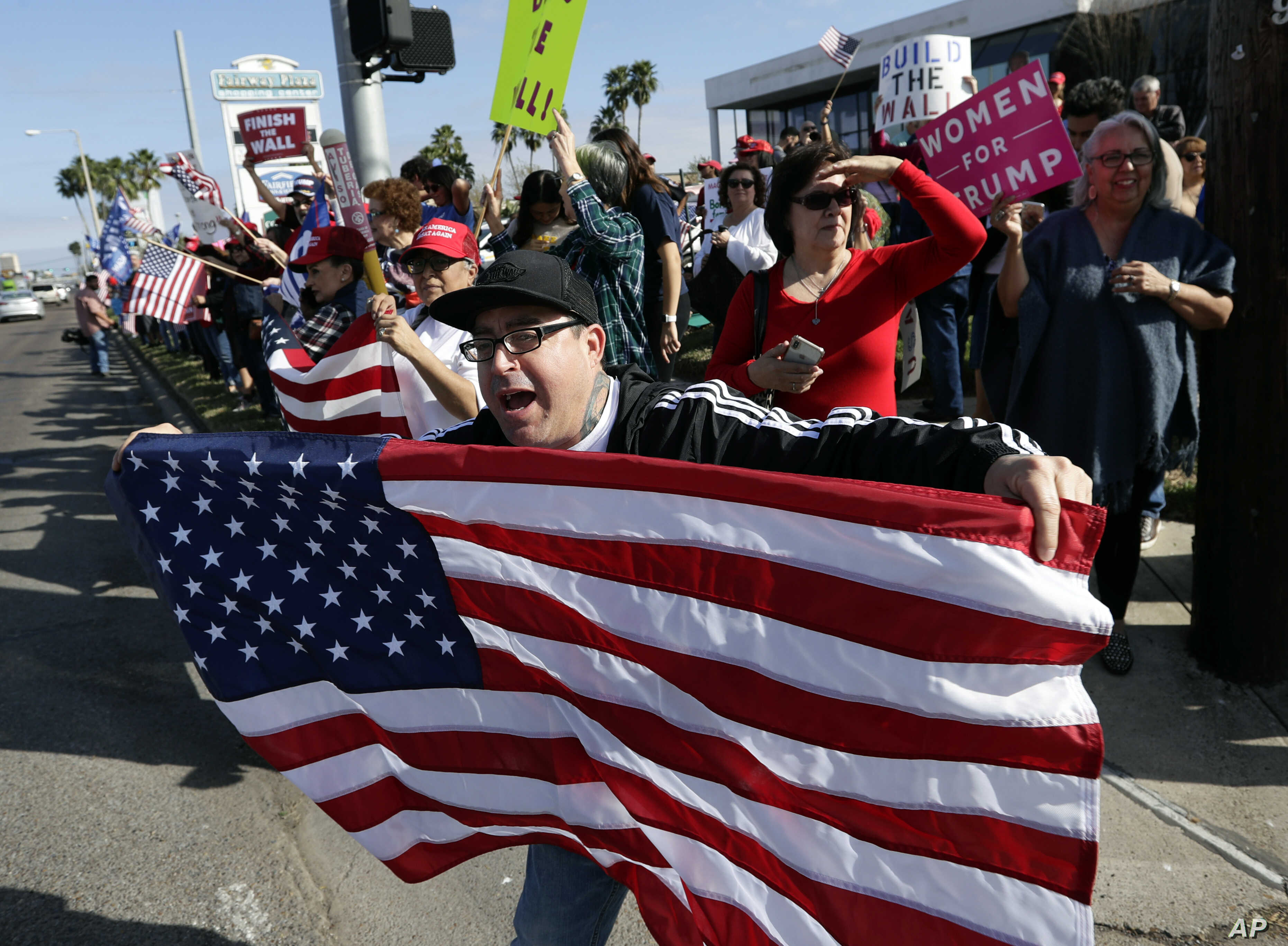 Supporters of President Donald Trump gather outside the McAllen International Airport for Trump's visit to the southern border, Jan. 10, 2019, in McAllen, Texas.