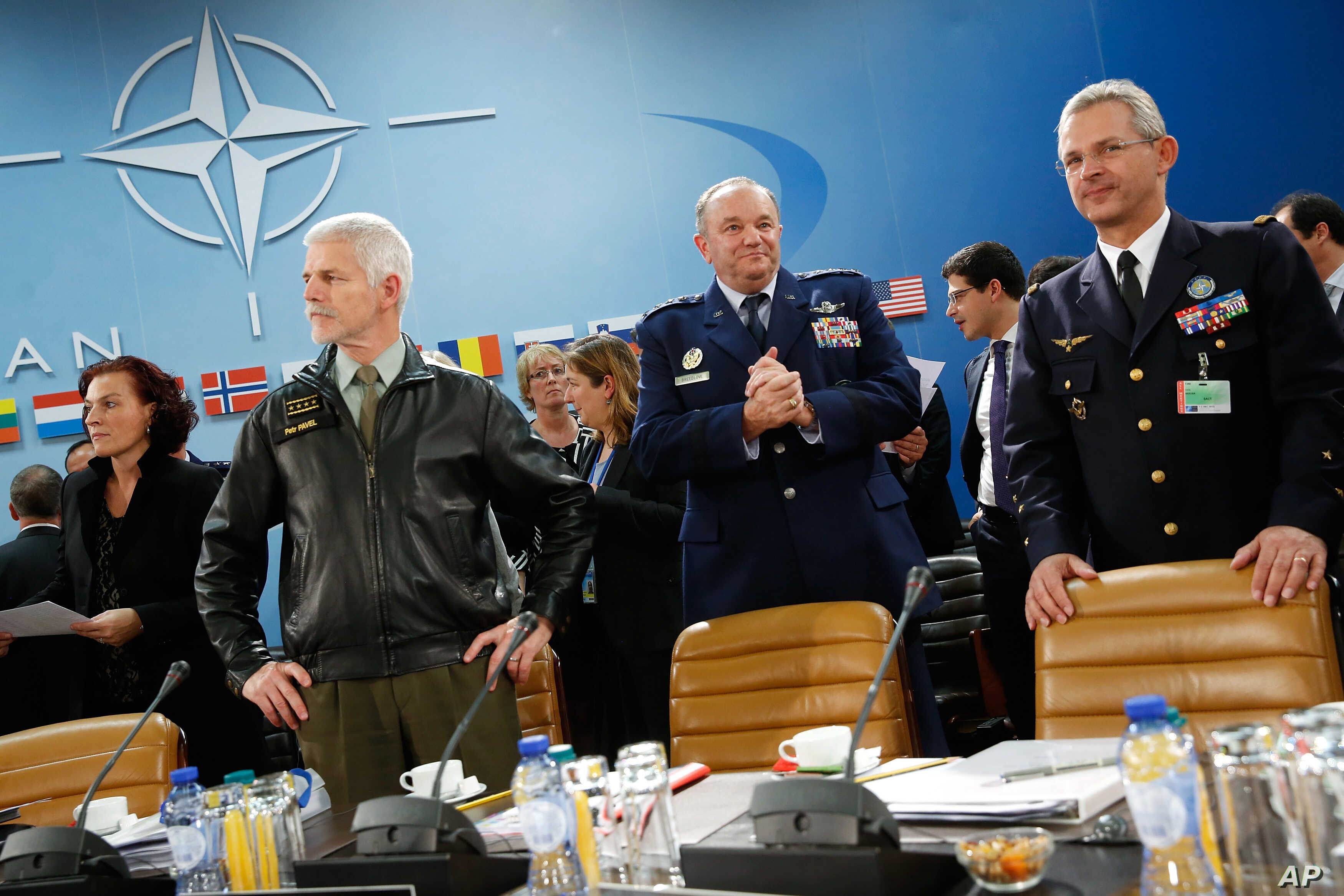 NATO commanders await the start of the NATO Ministerial Meeting on the South, Partnerships, and Defense Capacity at NATO Headquarters in Brussels, Dec. 1, 2015.