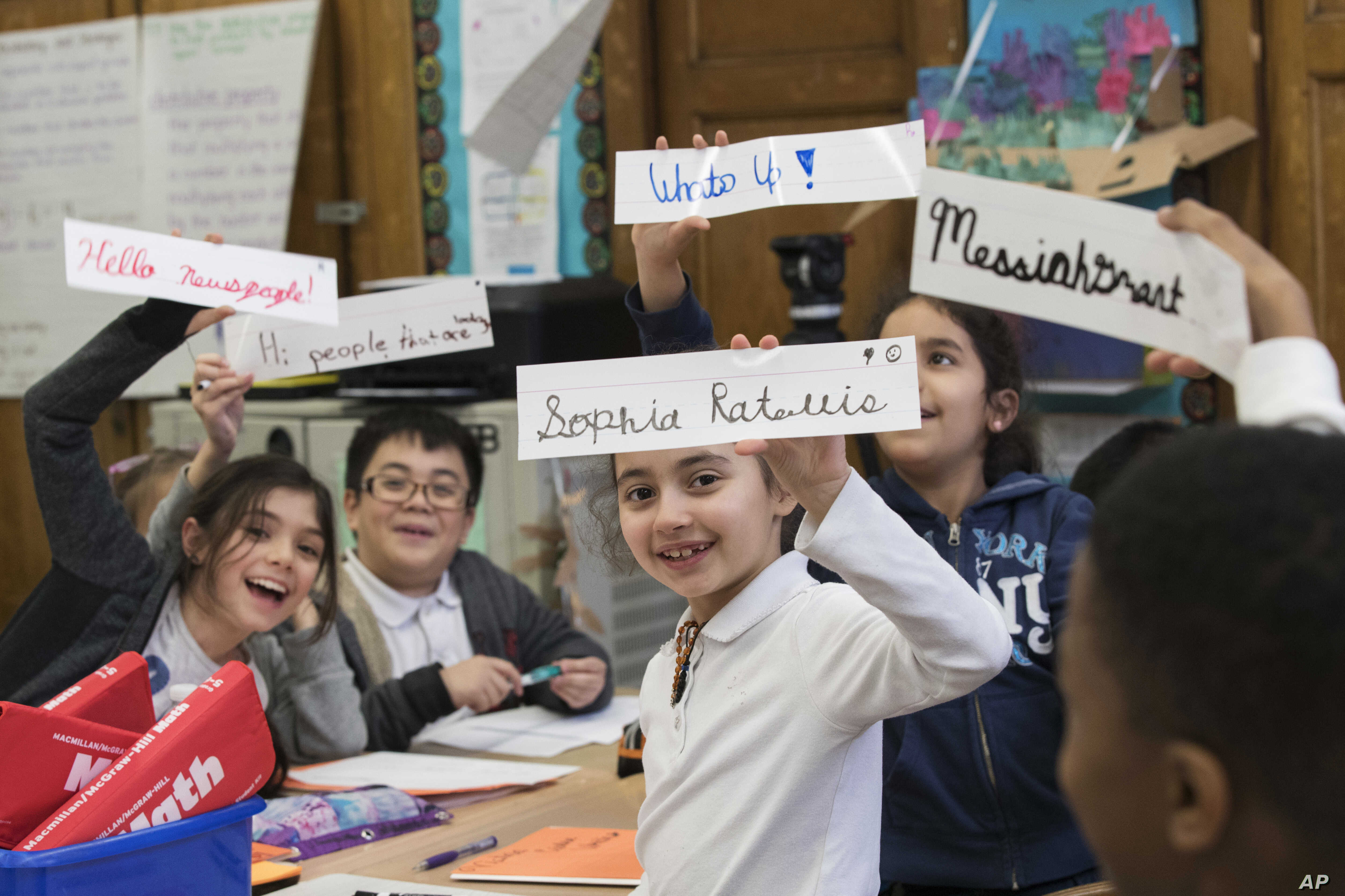 In this March 1, 2017, photo, students display some of their cursive writing work and exercises at P.S. 166 in the Queens borough of New York.