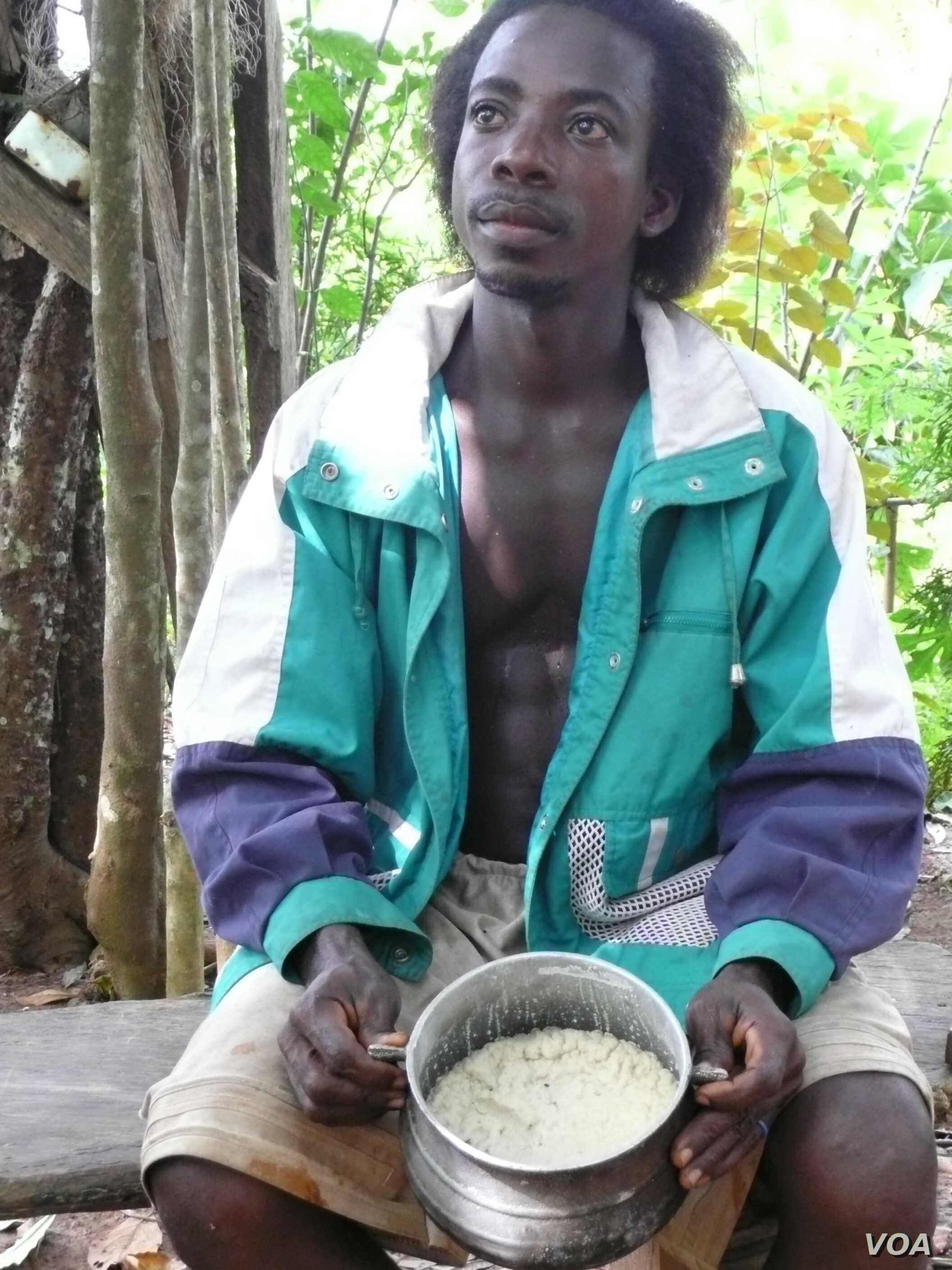 Farmer Yaw Obeng of Ghana with cooking fat made from Allanblackia seeds. (Credit: World Agro Forestry Centre/Charlie Pye-Smith)