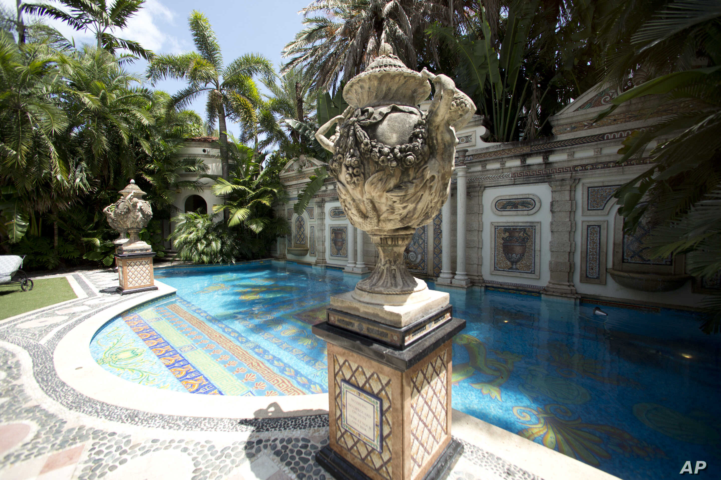 Decorative artwork stands in front of the 55-foot long swimming pool at the Versace mansion in Miami Beach, Fl.,  July 23, 2013.