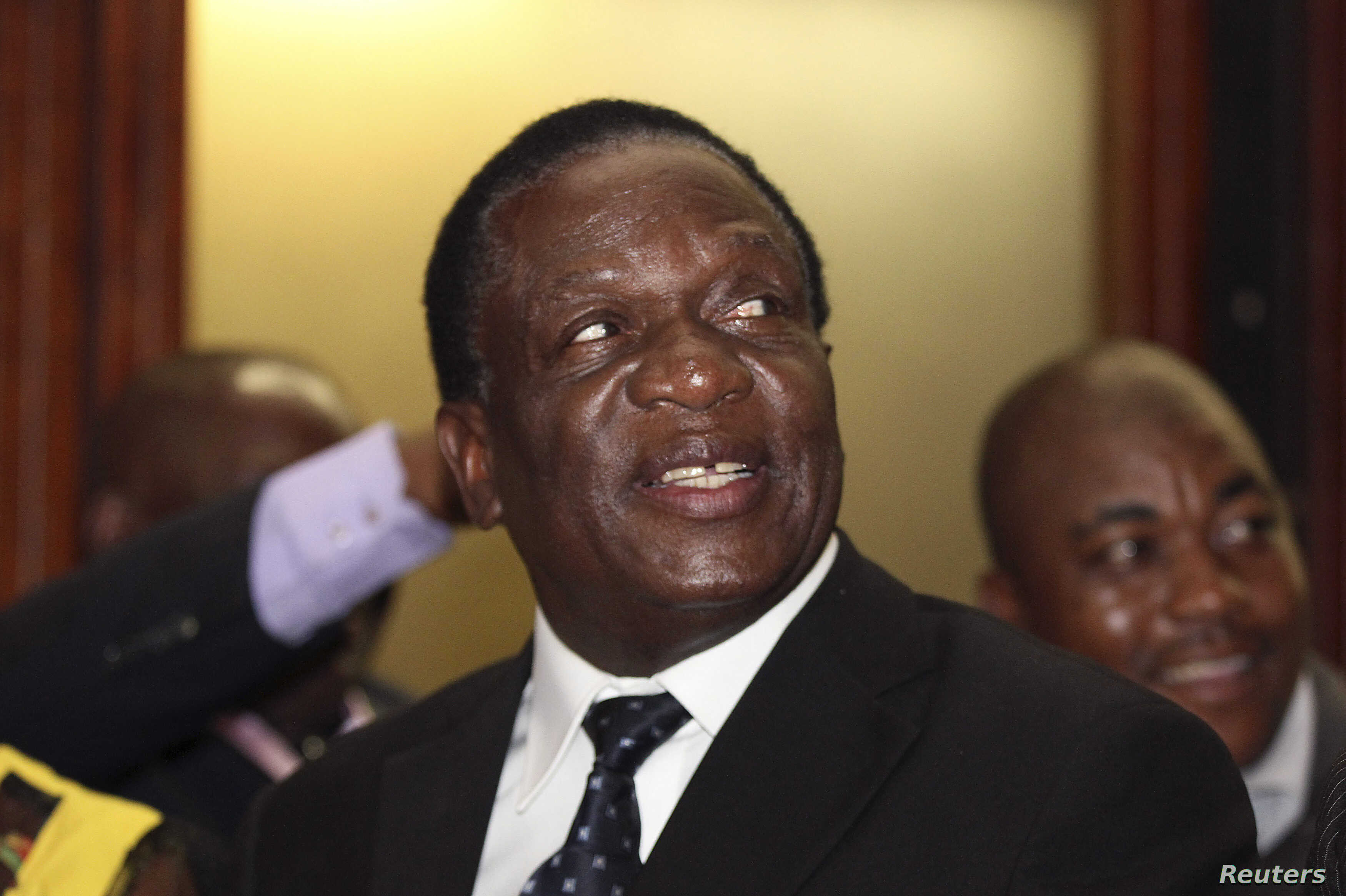 Newly appointed Zimbabwean Deputy President Emmerson Mnangagwa smiles at the headquarters of ZANU (PF) in Harare, Dec.10, 2014.