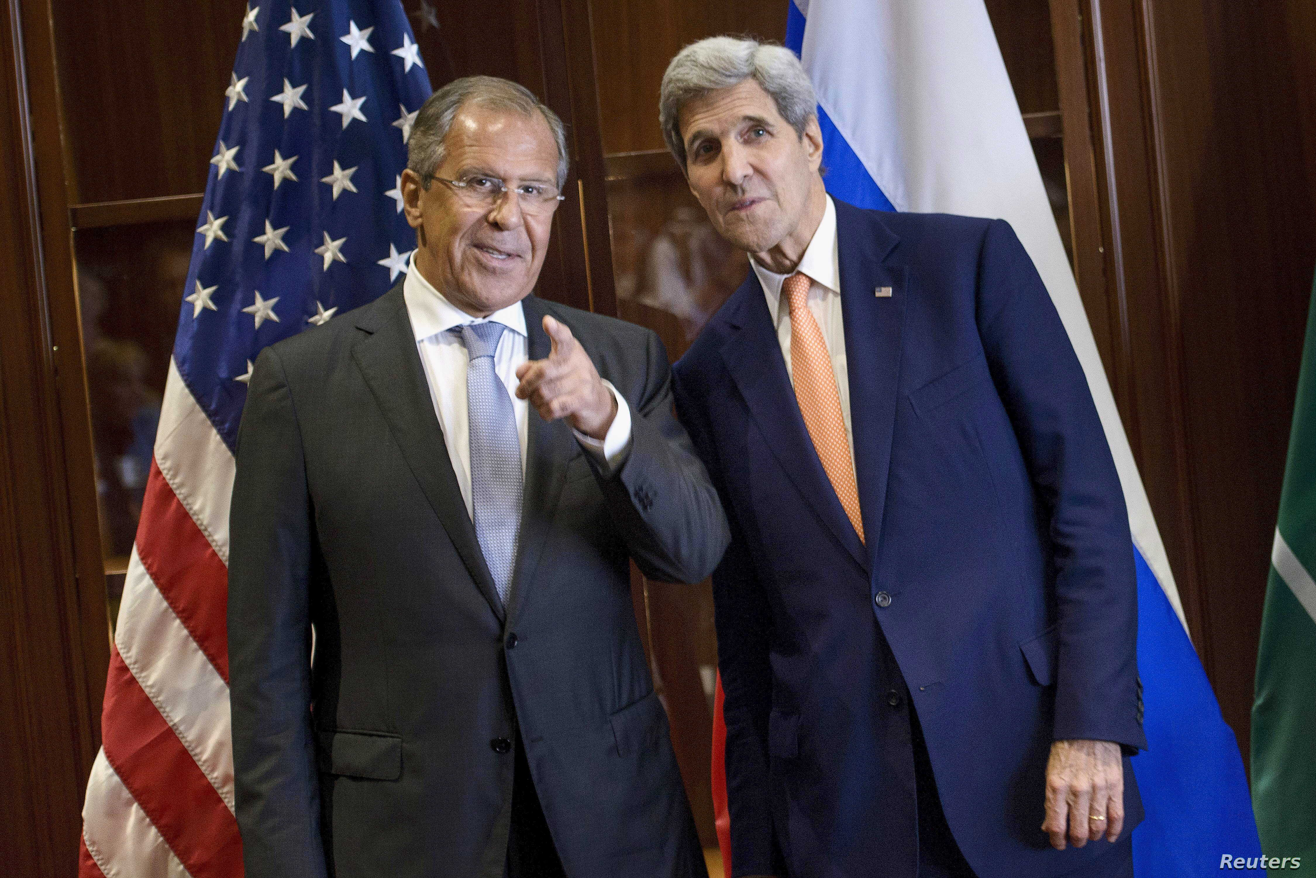 Russia's Foreign Minister Sergey Lavrov (L) and U.S. Secretary of State John Kerry talk before a trilateral meeting in Doha, Qatar Aug. 3, 2015.