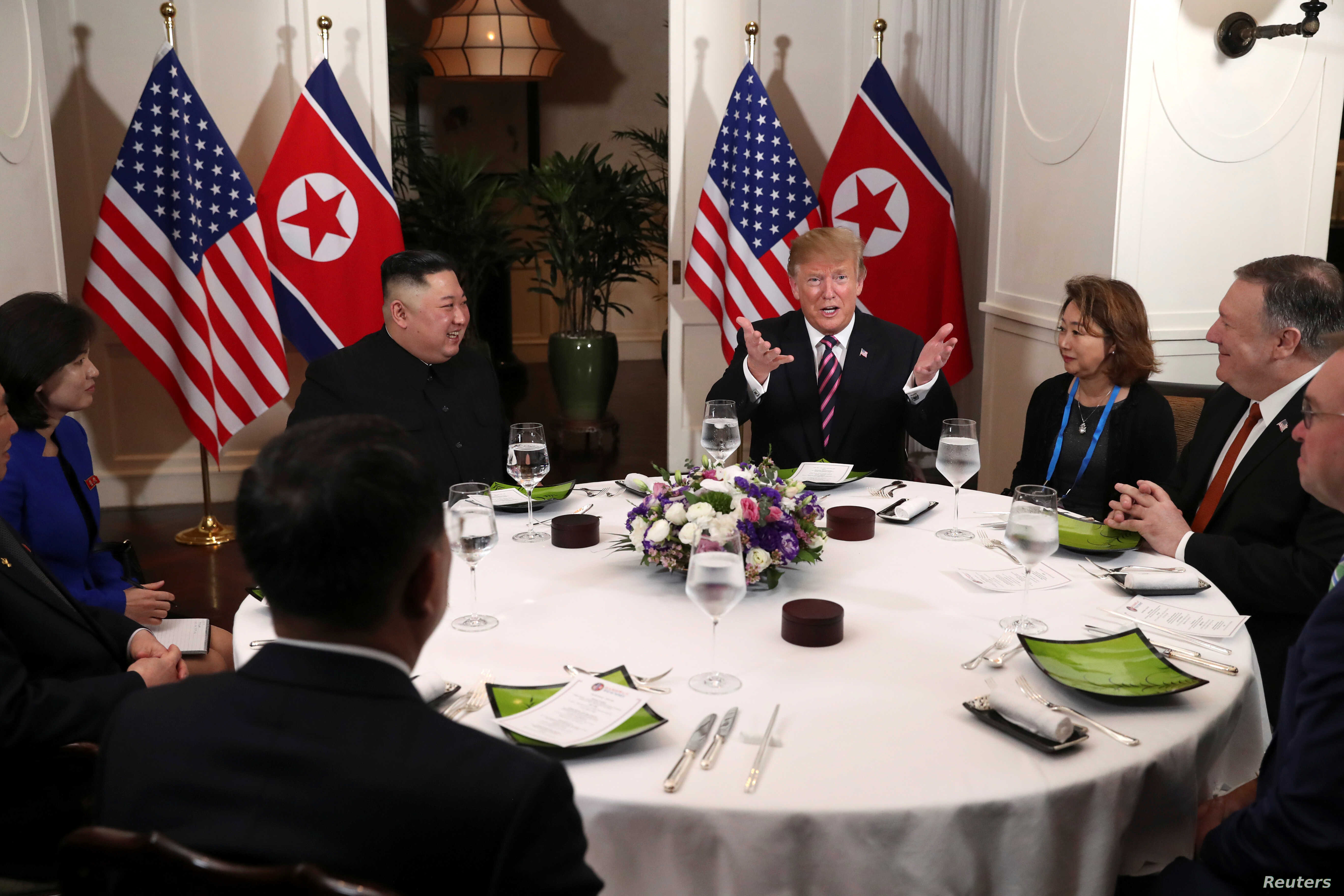 U.S. President Donald Trump and North Korean leader Kim Jong Un sit down for a dinner during the second U.S.-North Korea summit at the Metropole Hotel in Hanoi, Vietnam Feb. 27, 2019.