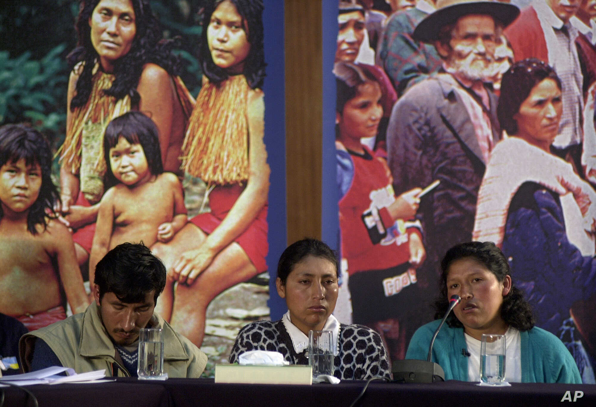 Silvia Flores, right, testifies while Celestina Flores, center,  and her husband listen, during a public hearing of Peru's Truth and Reconciliation Commission in Lima, Sept. 10,  2002. The commission has begun public sessions to hear testimonies by w...