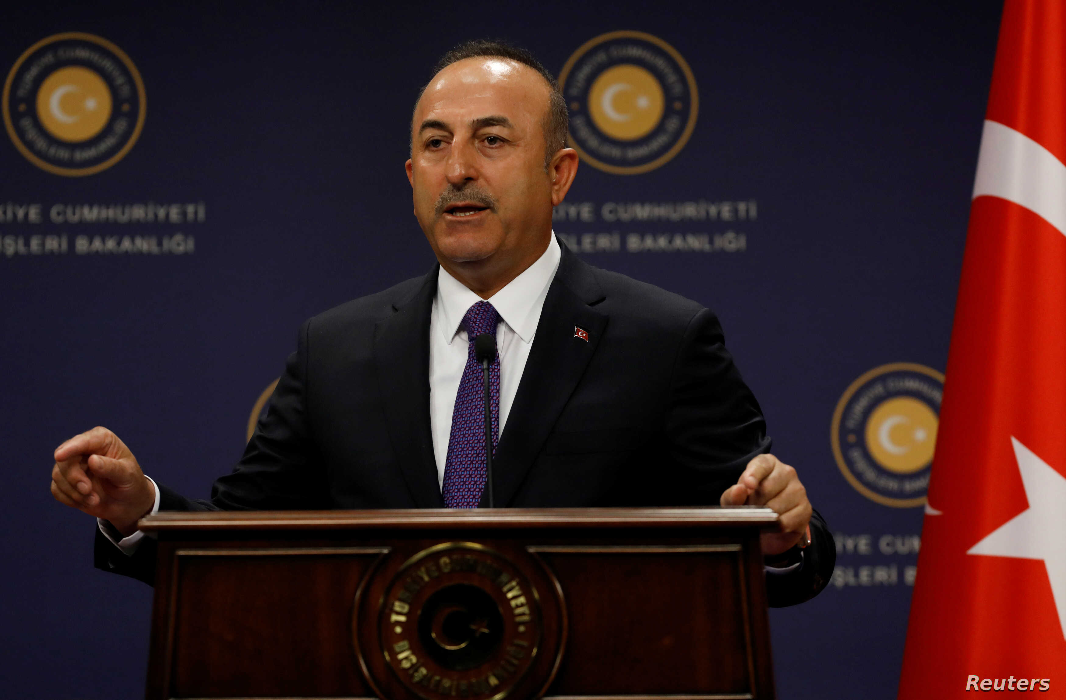 Turkish Foreign Minister Mevlut Cavusoglu gestures during a news conference in Ankara, Turkey, April 16, 2018.