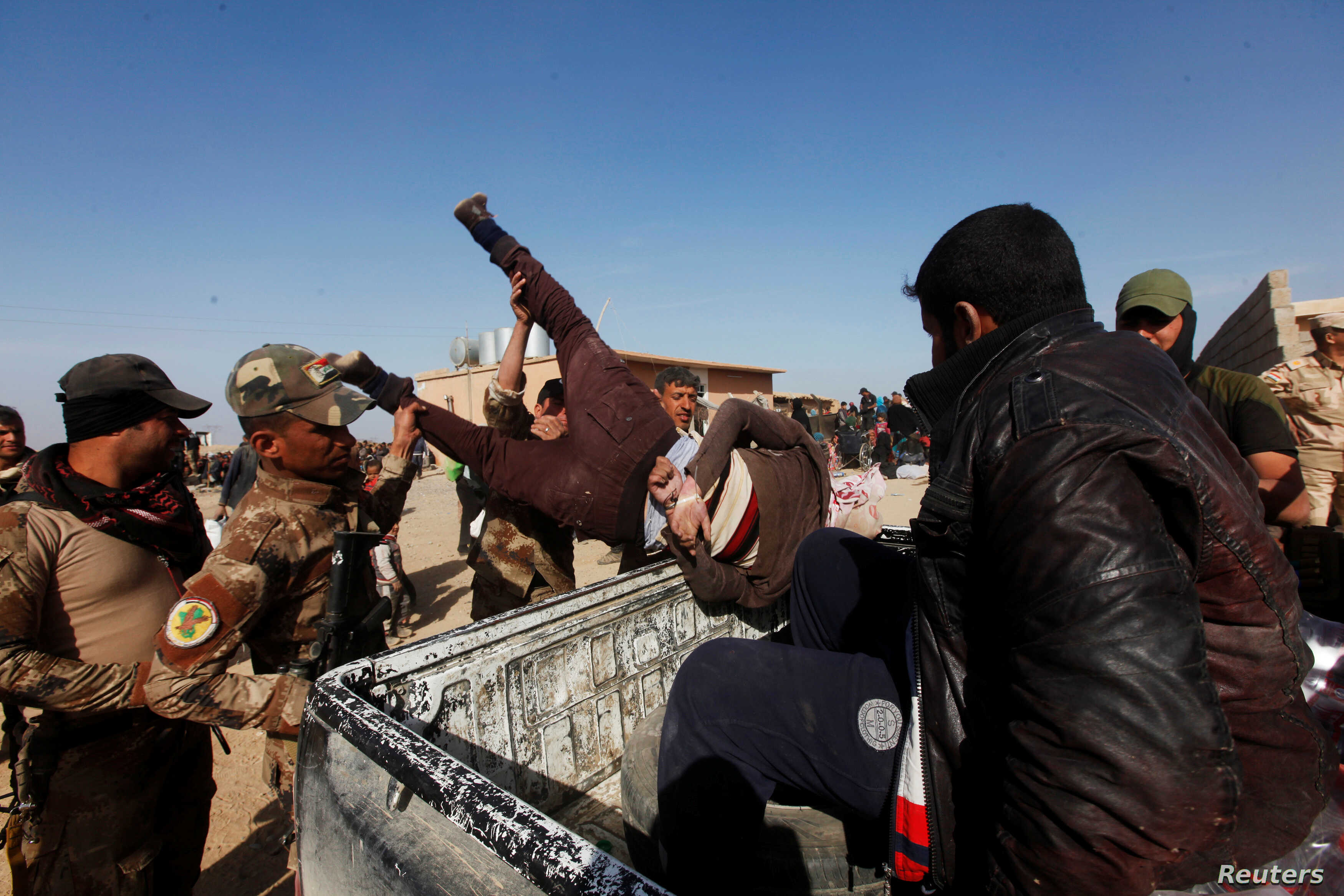Iraqi Special Operations Forces arrest a person suspected of belonging to Islamic State militants in western Mosul, Iraq February 26, 2017.