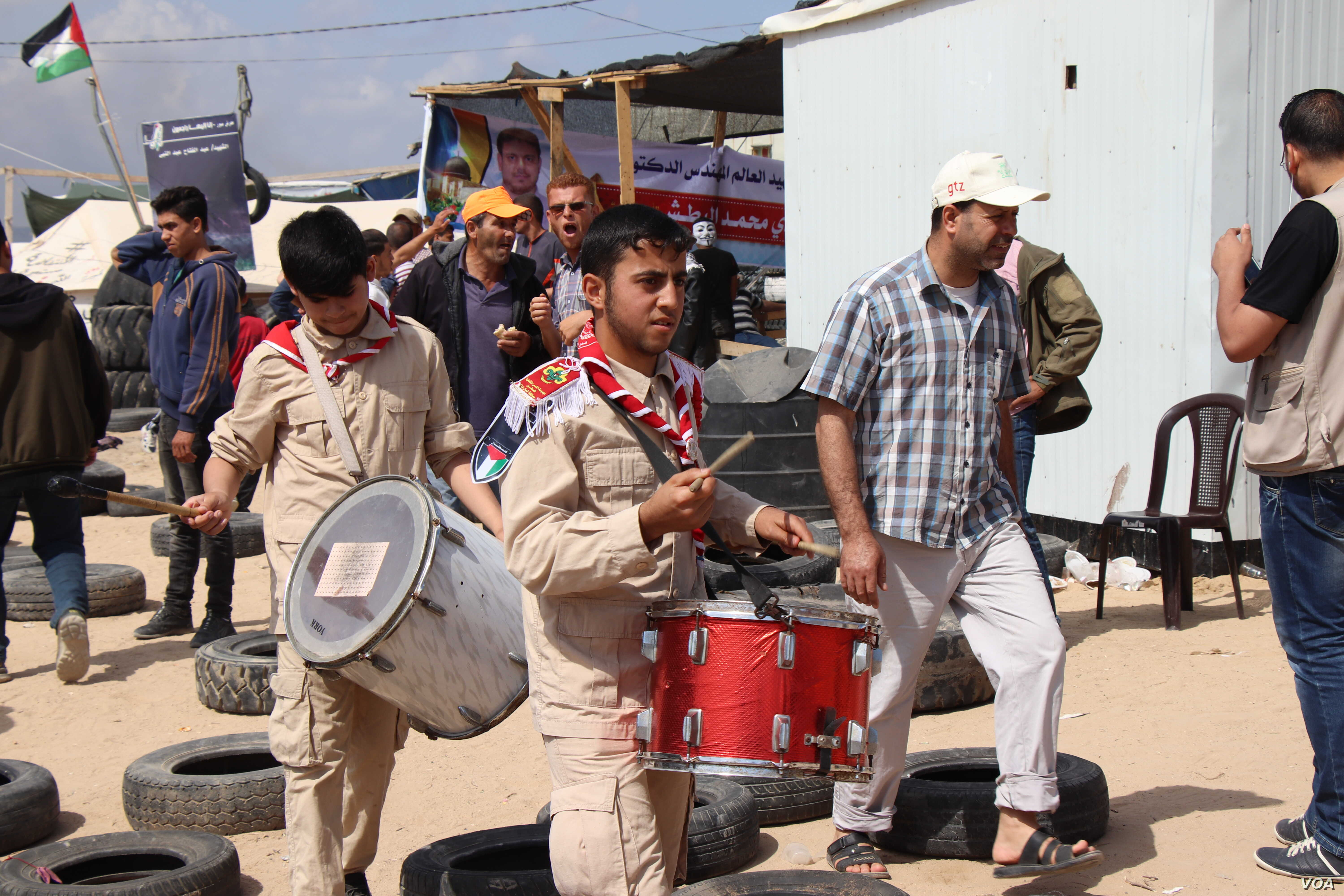 Boys play the drums to excite protesters who say that even after 70 years of displacement, they still want to return to their homes in the Gaza Strip, May 14, 2018.