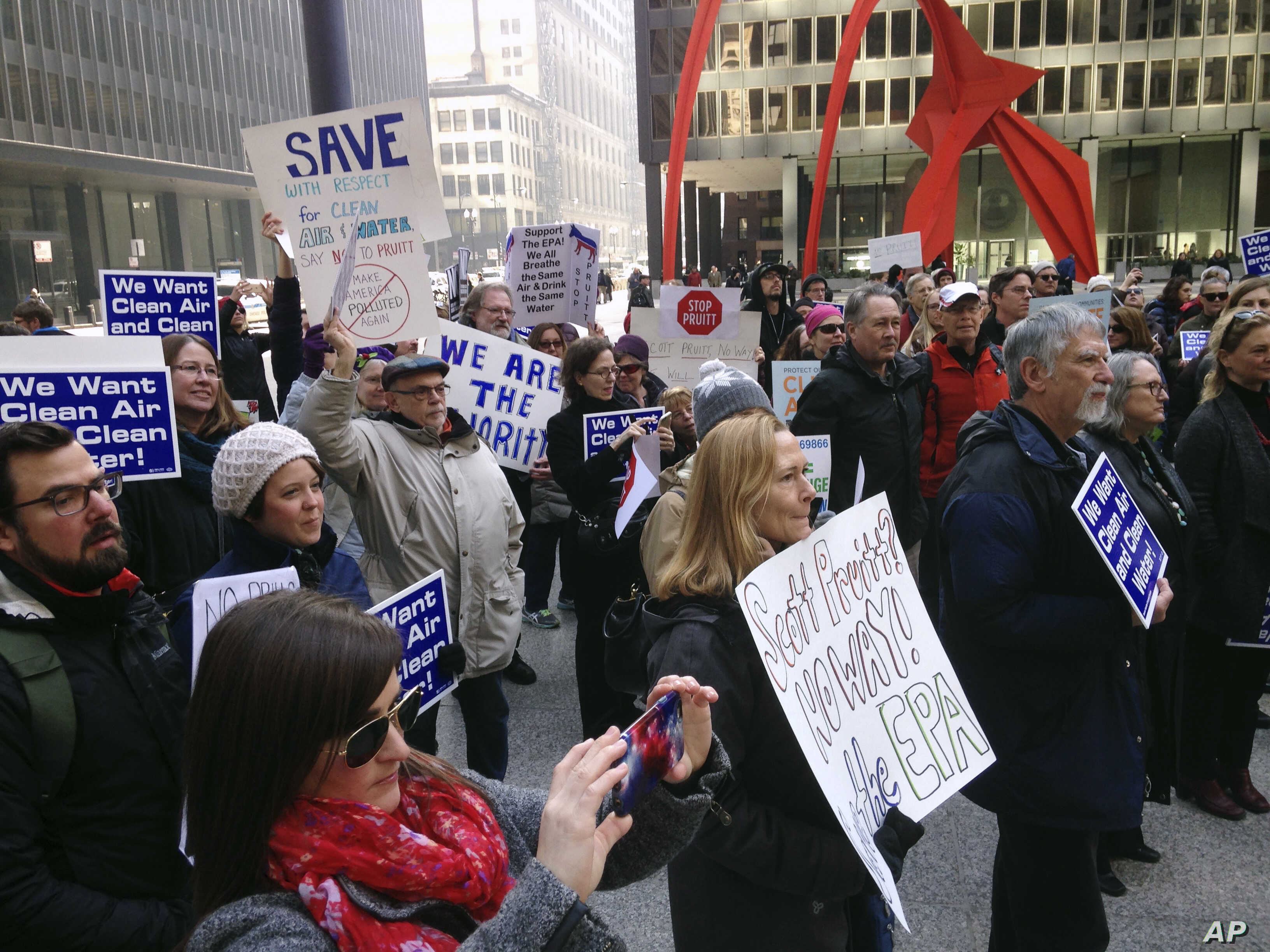 Environmental Protection Agency employees and environmental activists gather in Chicago, Feb. 6, 2017, to protest the nomination of Scott Pruitt for administrator of the agency.