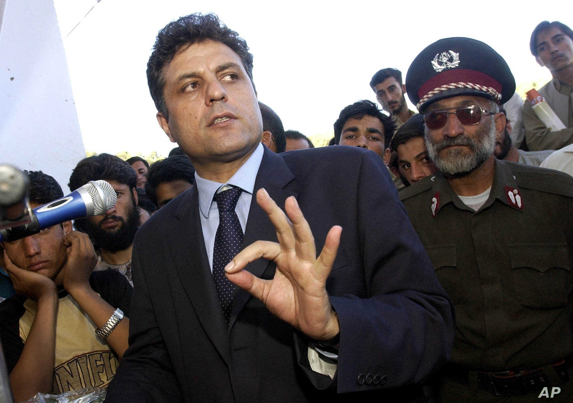 FILE - Presidential candidate Abdul Latif Pedram gestures as he speaks to supporters during a campaign stop at a stadium of western city in Herat, Afghanistan, Oct. 3, 2004.