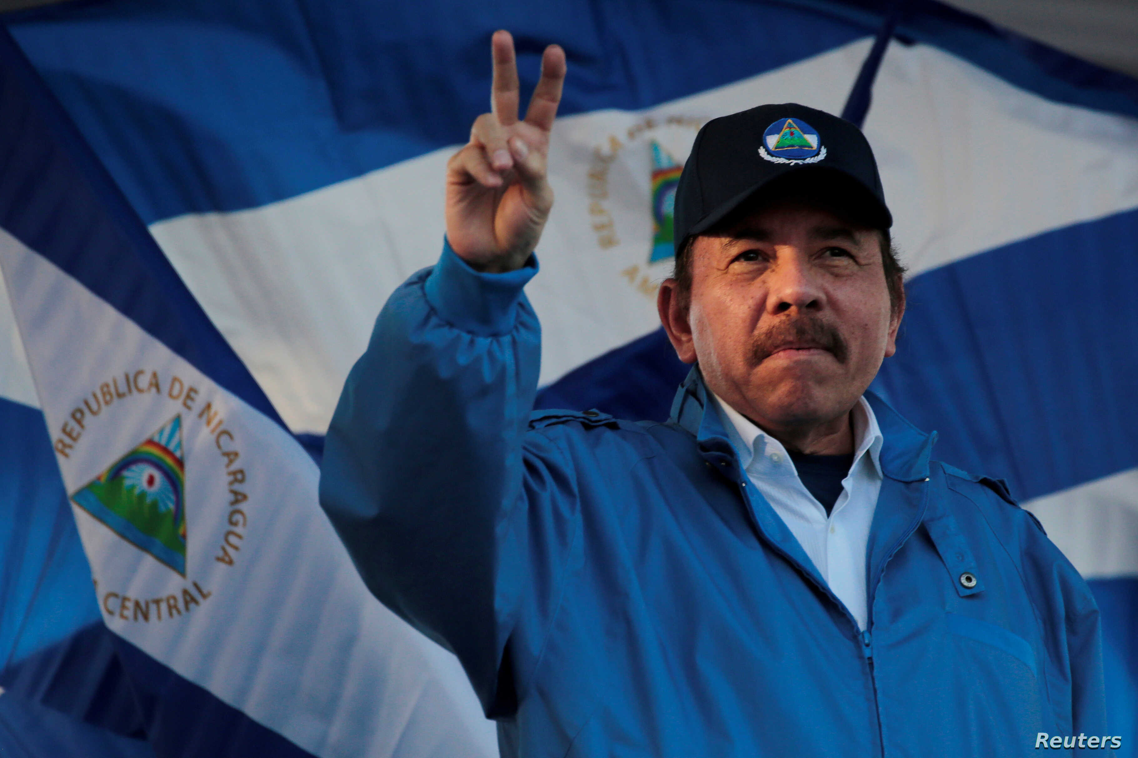 """FILE - Nicaraguan President Daniel Ortega gestures during a march called """"We walk for peace and life. Justice"""" in Managua, Nicaragua, Sept. 5,2018."""