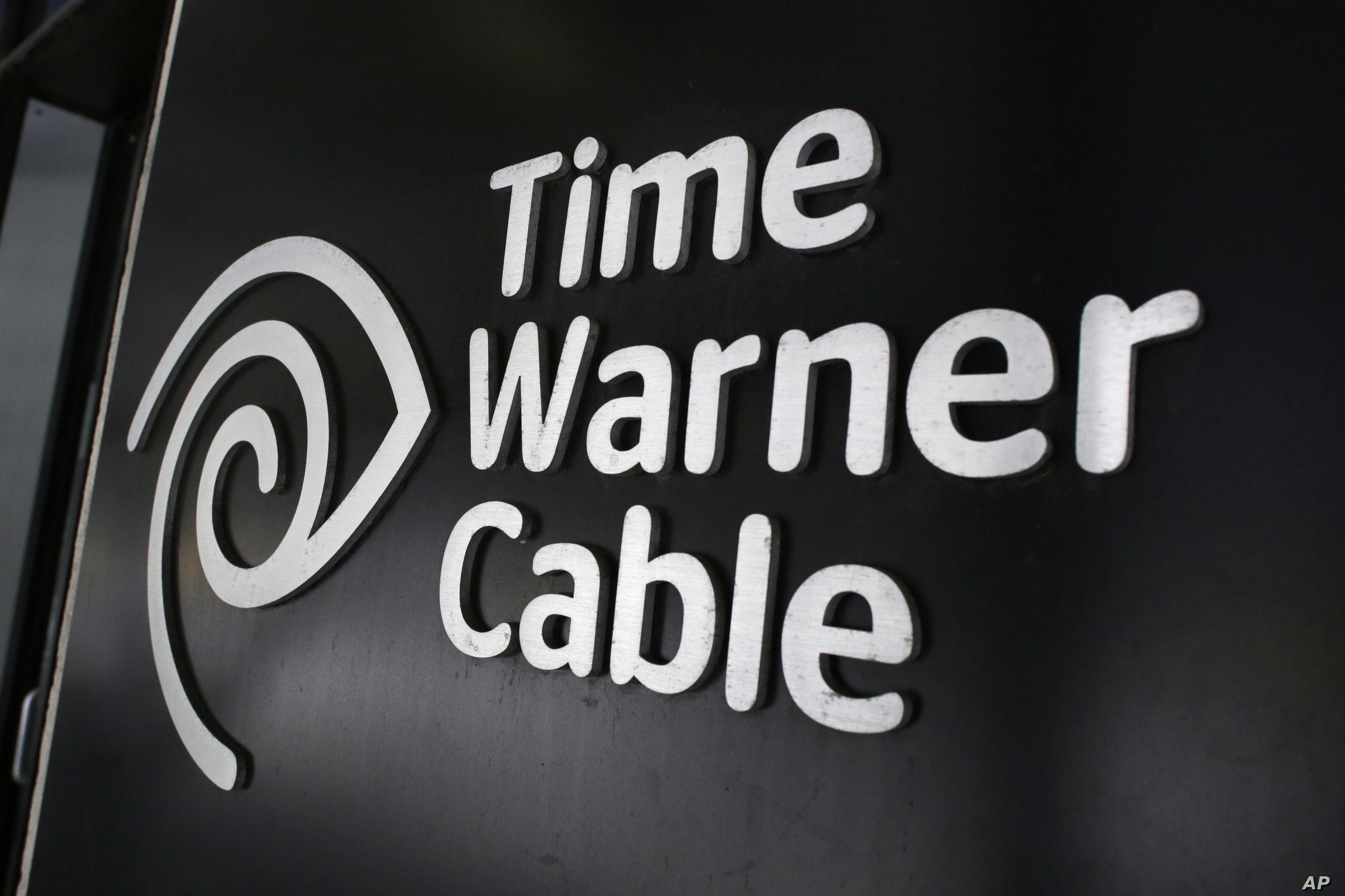 FILE - The Time Warner Cable corporate logo is displayed at a company store, in New York, May 26, 2015. U.S. lawmakers are skeptical about the entertainments giant's proposed merger with telecommunications powerhouse AT&T.