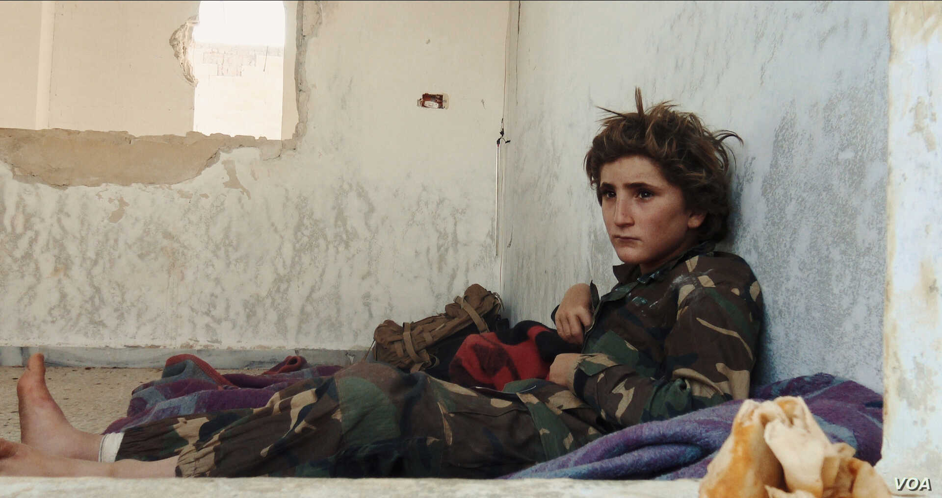 Osama, 13, wears a military uniform in a youth training camp run by former al-Qaida-affiliated group al-Nusra Front. (Kahtan Hasson for VOA)