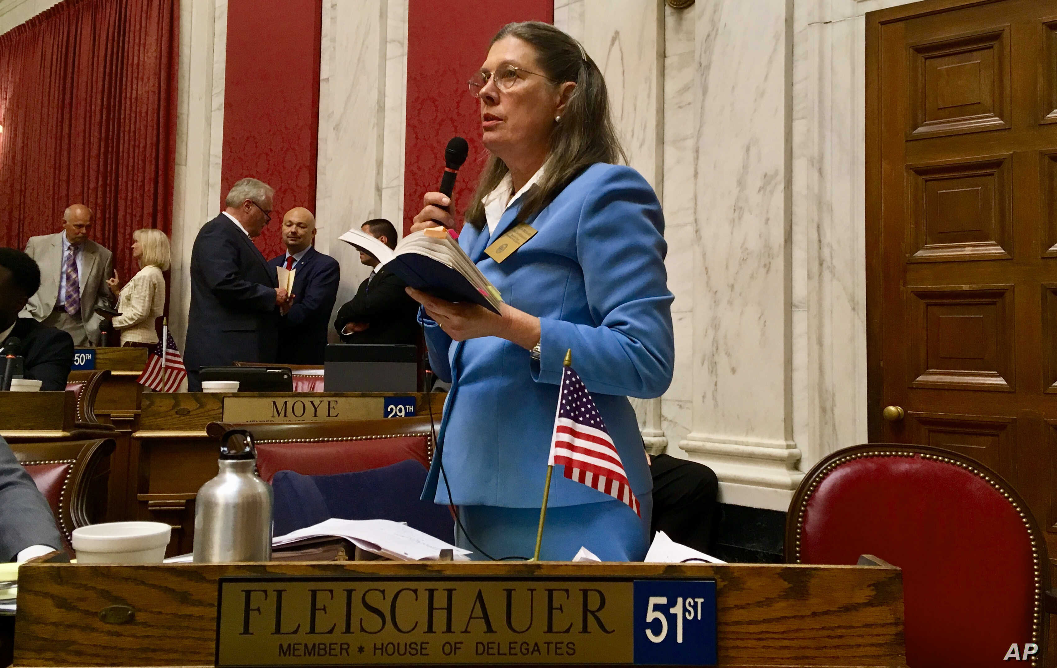 Democratic Delegate Barbara Evans Fleischauer asks a question, Aug. 13, 2018, during an impeachment hearing involving West Virginia Supreme Court justices in the House of Delegates chambers in Charleston, W.Va.