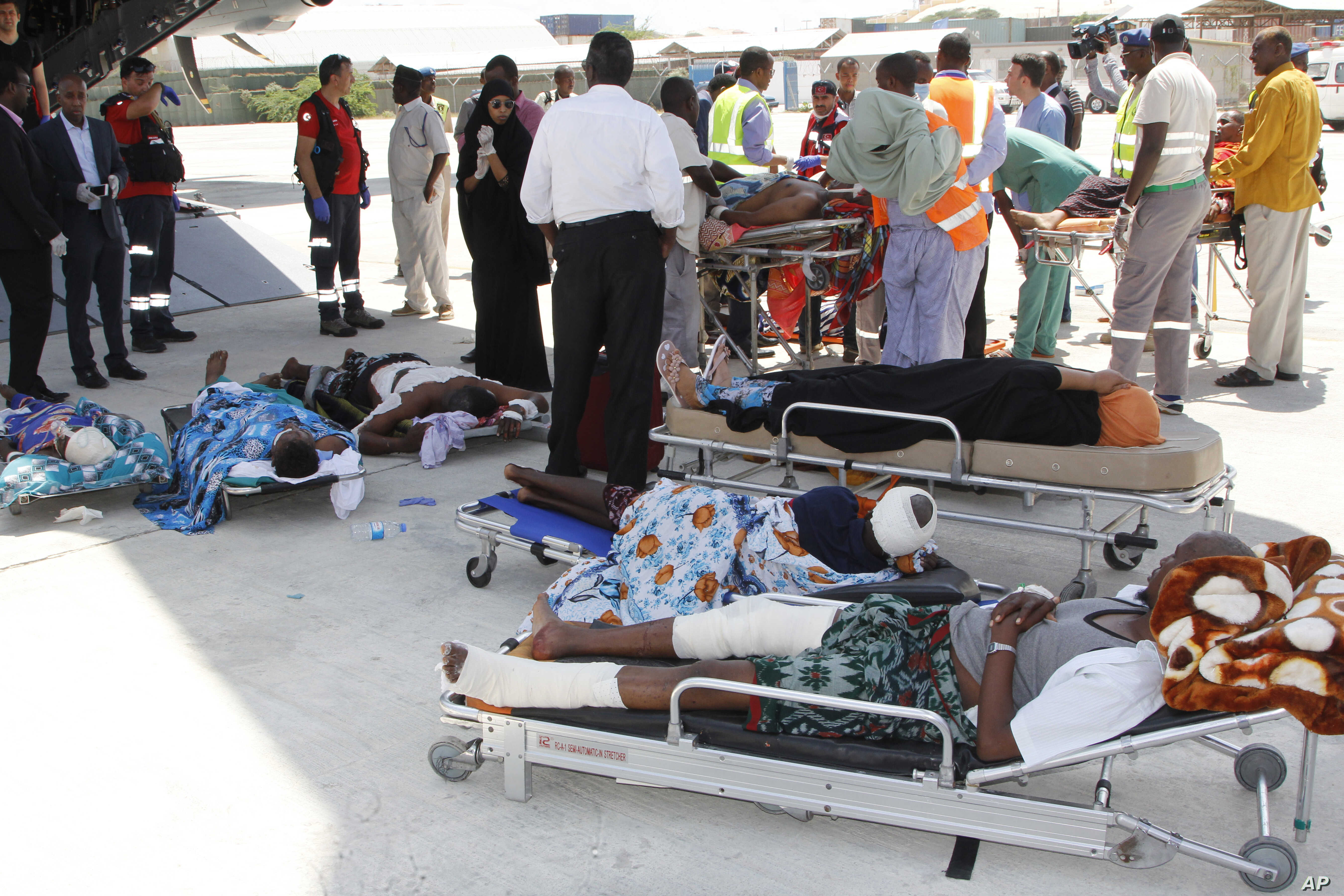 Critically wounded people wait to be moved into a waiting Turkish plane to be airlifted for treatment in Turkey, in Mogadishu, Somalia, Oct, 16, 2017.