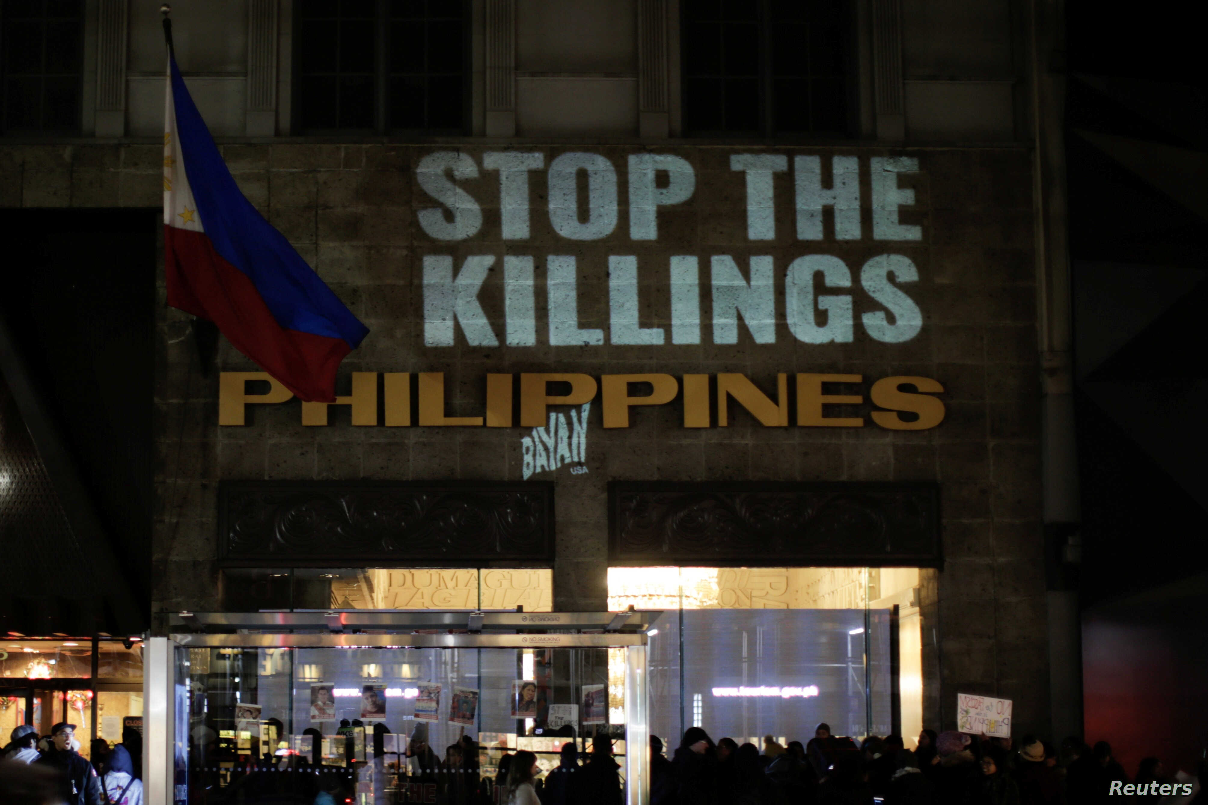 People take part in a protest against the government of Philippine President Rodrigo Duterte in front of the Philippine consulate in New York, Dec. 10, 2017.