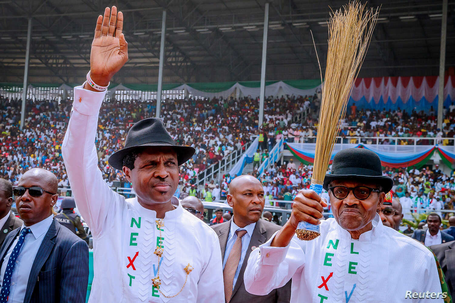 Nigeria's President Muhammadu Buhari greets his supporters during a campaign rally ahead of the country's presidential election in Rivers State, Nigeria, Feb. 12, 2019.