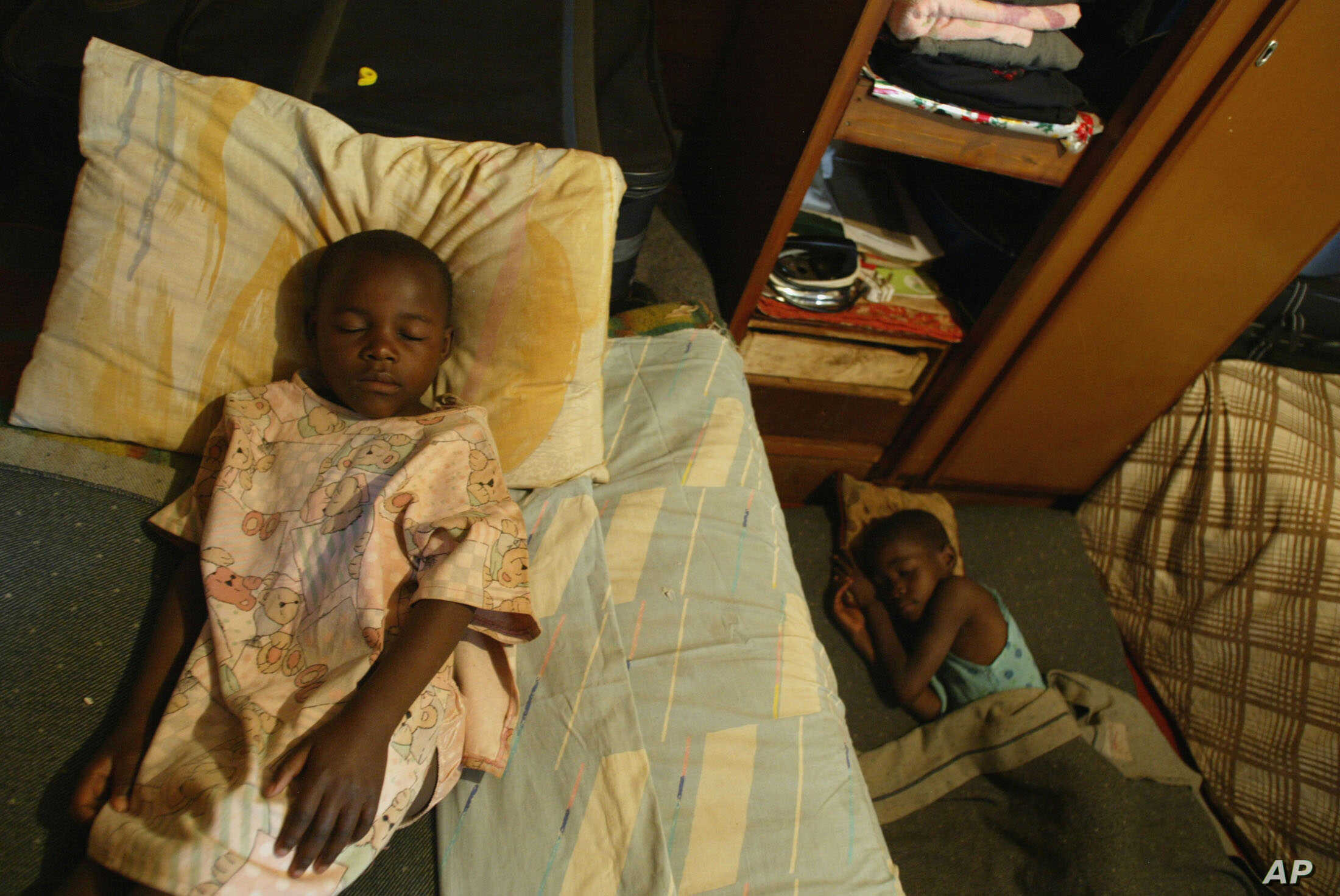 FILE - Children take an afternoon nap at an orphanage in Harare, Zimbabwe, May 26, 2006. One of the biggest problems caused by AIDS in Africa is the number of children who are being orphaned as the disease kills their parents and guardians.