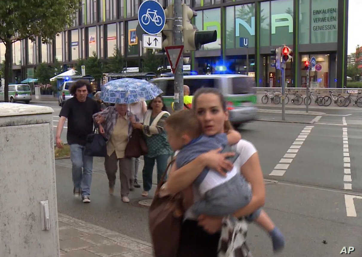Members of the public run away from the Olympia Einkaufszentrum mall, after a shooting, in Munich, Germany, July 22, 2016.