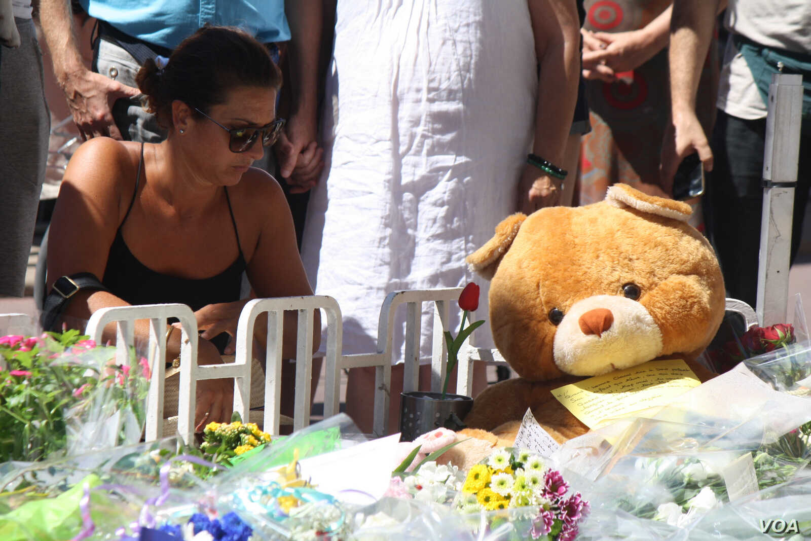 Toys are among the mementos placed on memorials in Nice, France to commemorate the deaths of ten children, July 16, 2016. (H.Murdock/VOA)