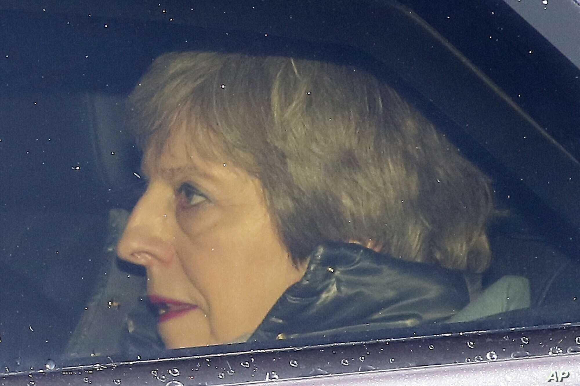 Britain's Prime Minister Theresa May arrives at the Houses of Parliament in London, March 12, 2019.