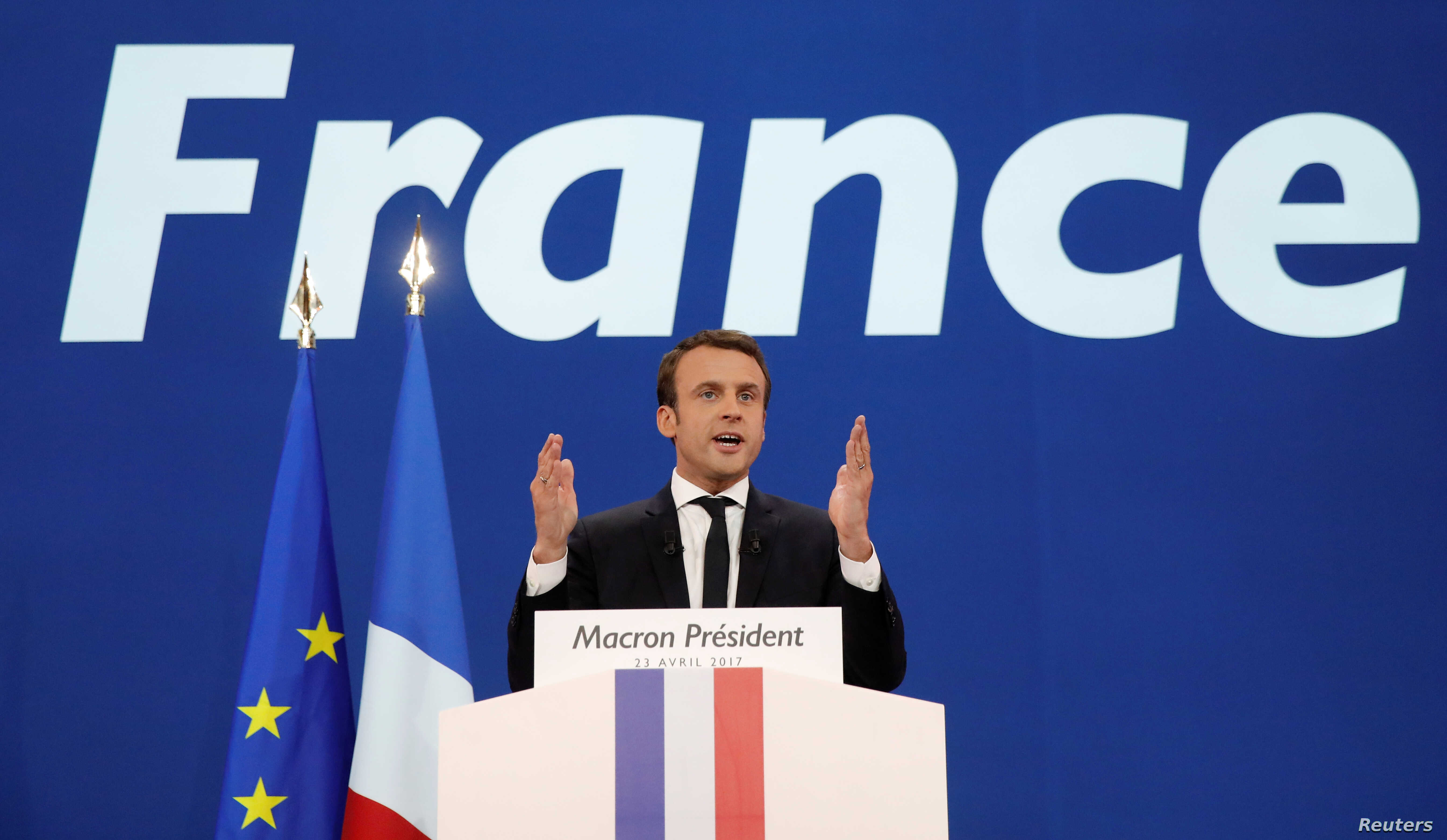 Emmanuel Macron, head of the political movement En Marche !, or Onwards !, and candidate for the 2017 French presidential election, gestures to supporters after the first round of 2017 French presidential election in Paris, April 23, 2017.