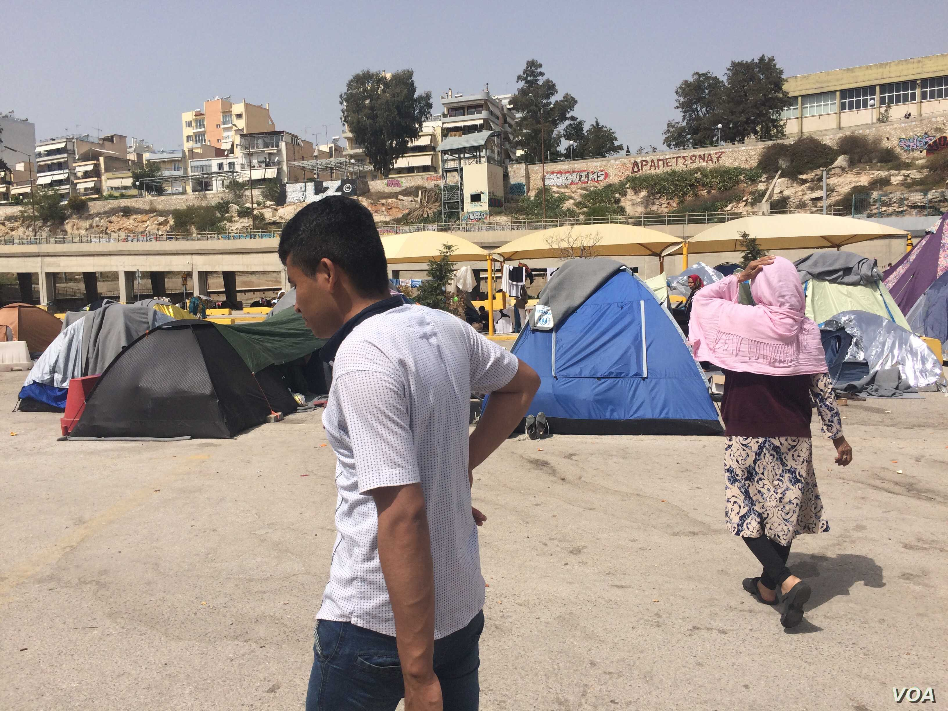 """The Greek government says it will close settlements on the port that house thousands of people.  Many say they don't plan to go to """"official"""" camps for fear of worse conditions or being detained, taken in Athens, Greece on April, 8, 2016. (H. Murdock..."""