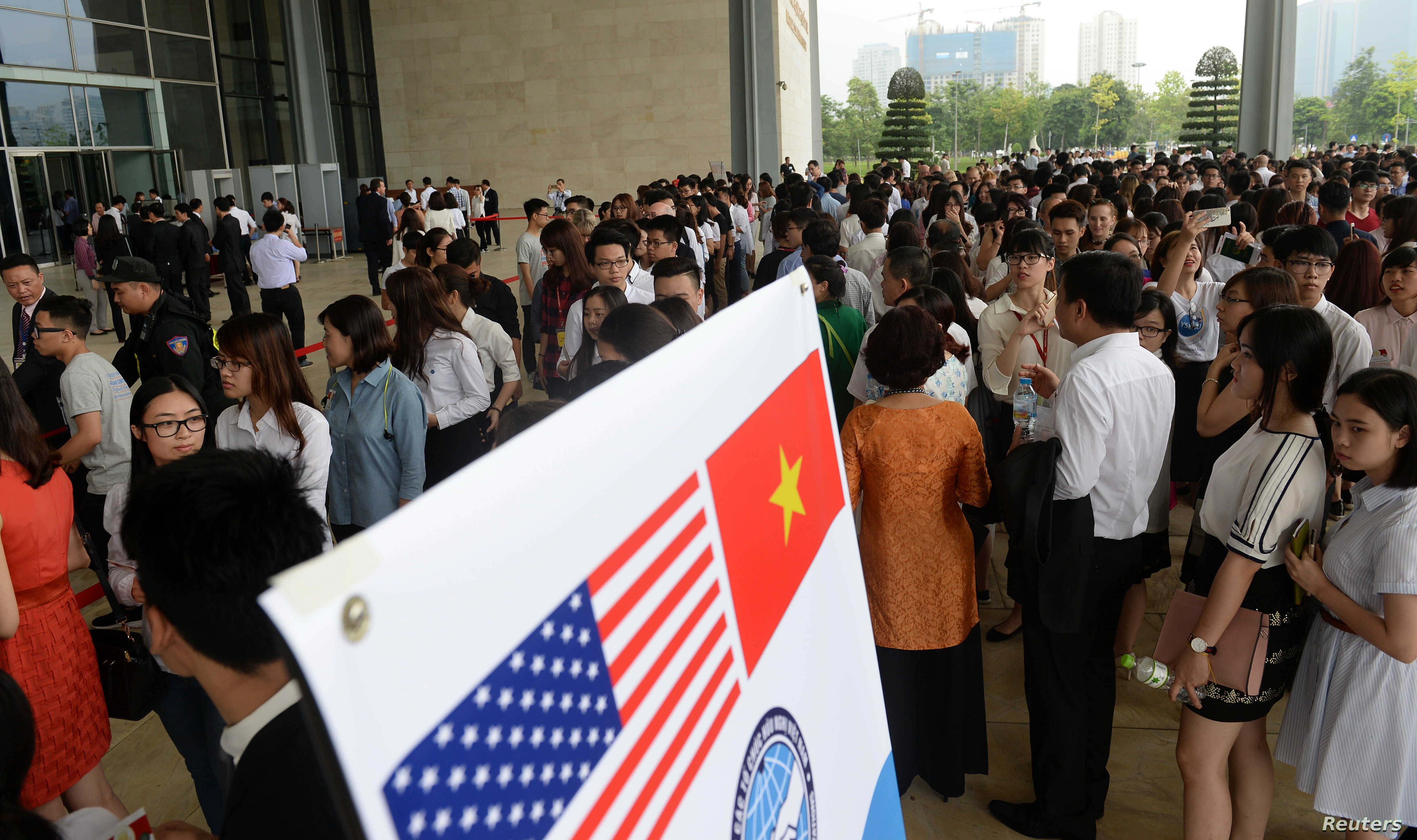 People wait to enter the National Convention Center, where U.S. President Barack Obama will deliver a speech, in Hanoi, May 24, 2016.