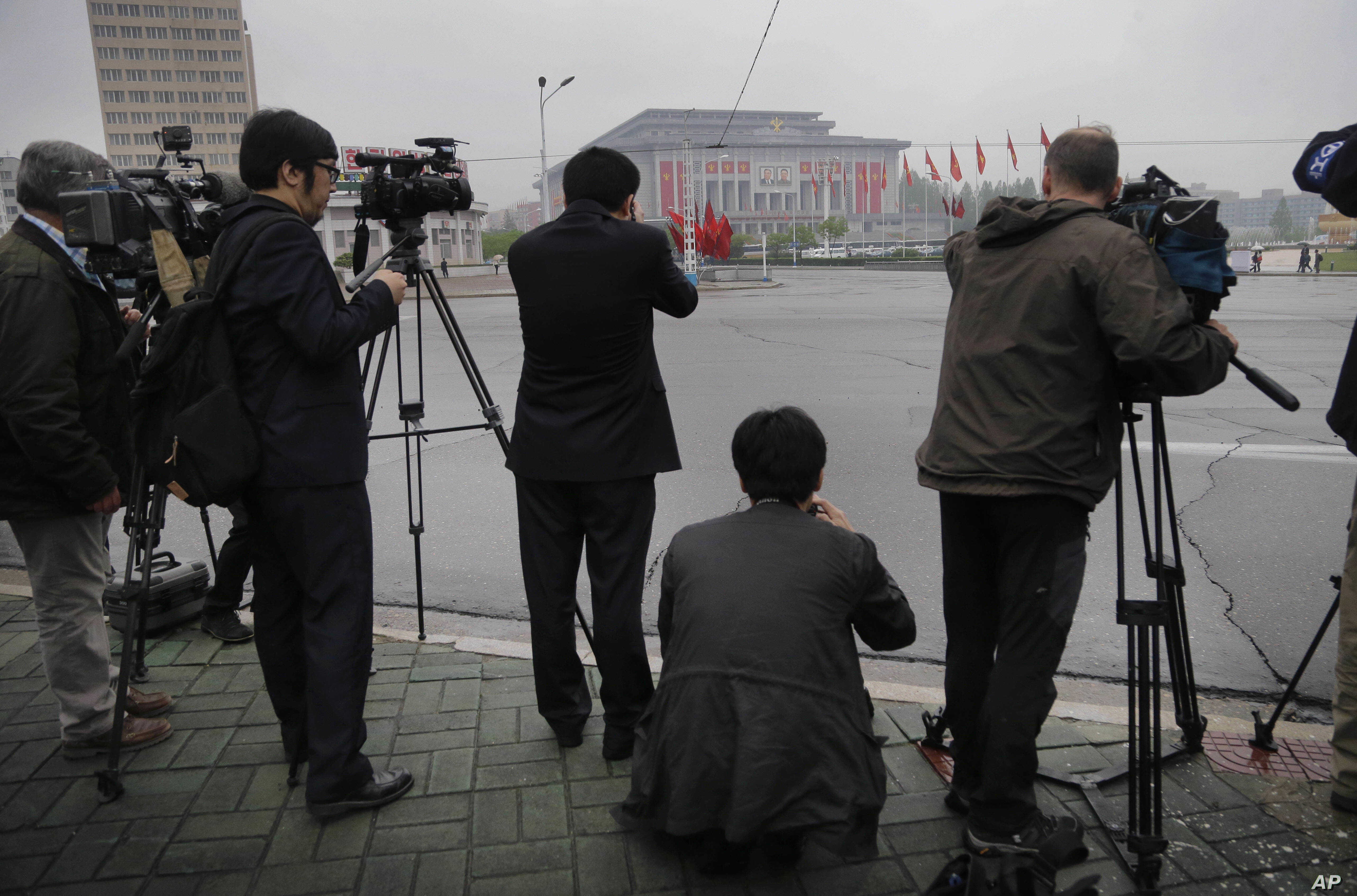 Foreign journalists are seen filming the April 25 House of Culture, the venue for the 7th Congress of the Workers' Party of Korea, on May 6, 2016, in Pyongyang, North Korea.