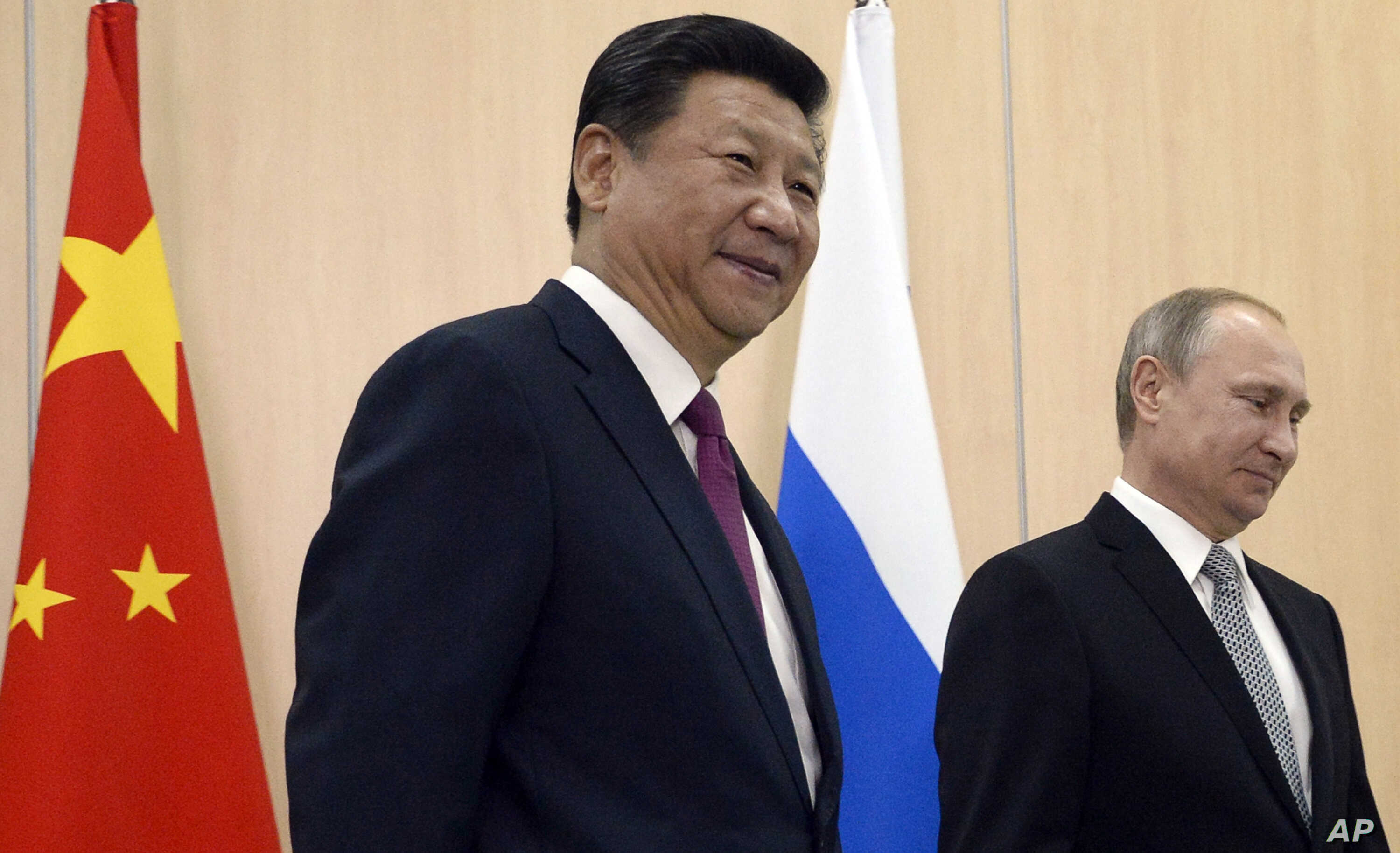 FILE - Chinese President Xi Jinping smiles before a meeting with Russian leader Vladimir Putin in Ufa, Russia.