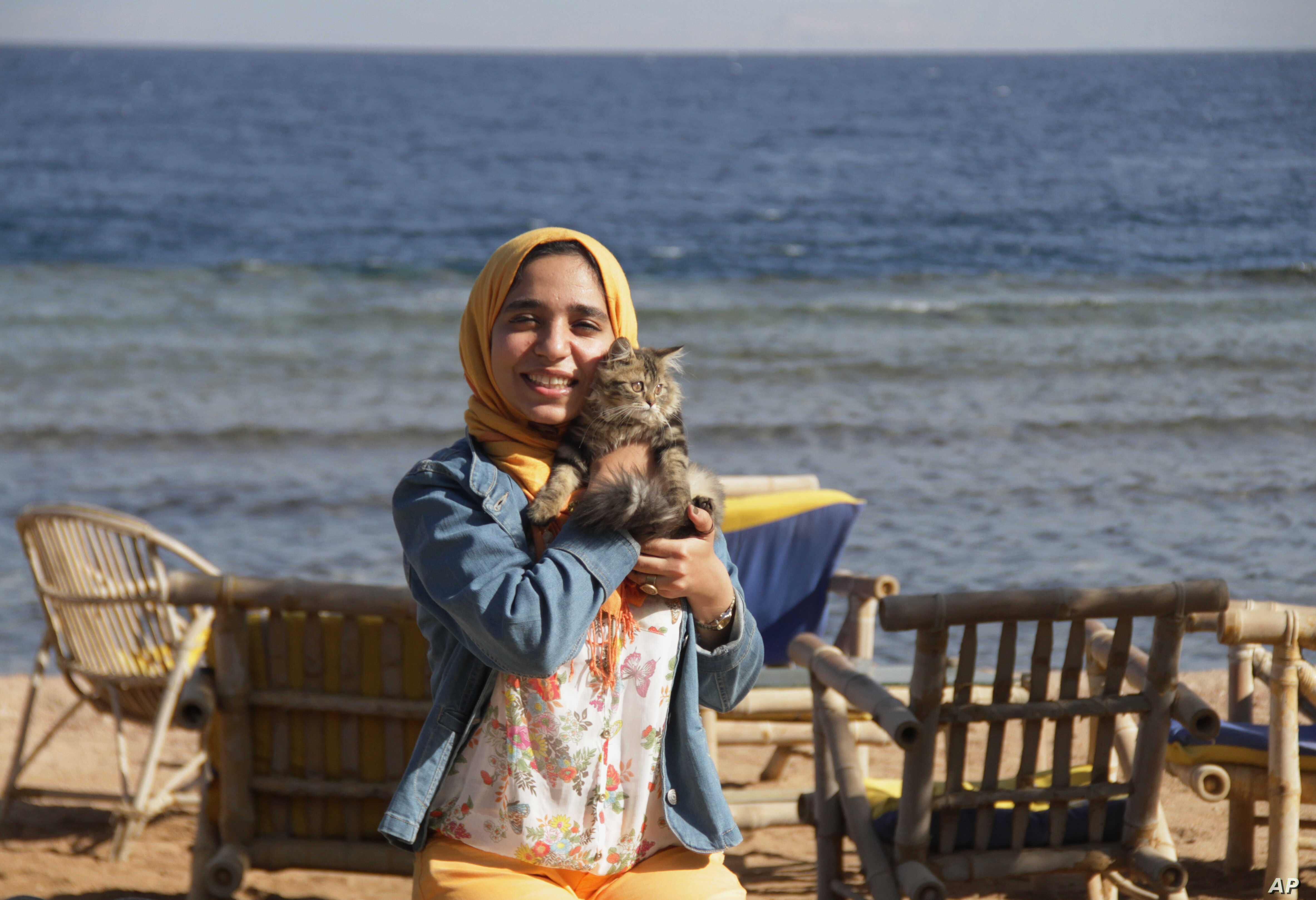 In this photo provided by el-Taweel family on Friday, Aug. 7, 2015, jailed Egyptian photographer Esraa el-Taweel poses for a photo in Egypt's Dahab beach in 2015.