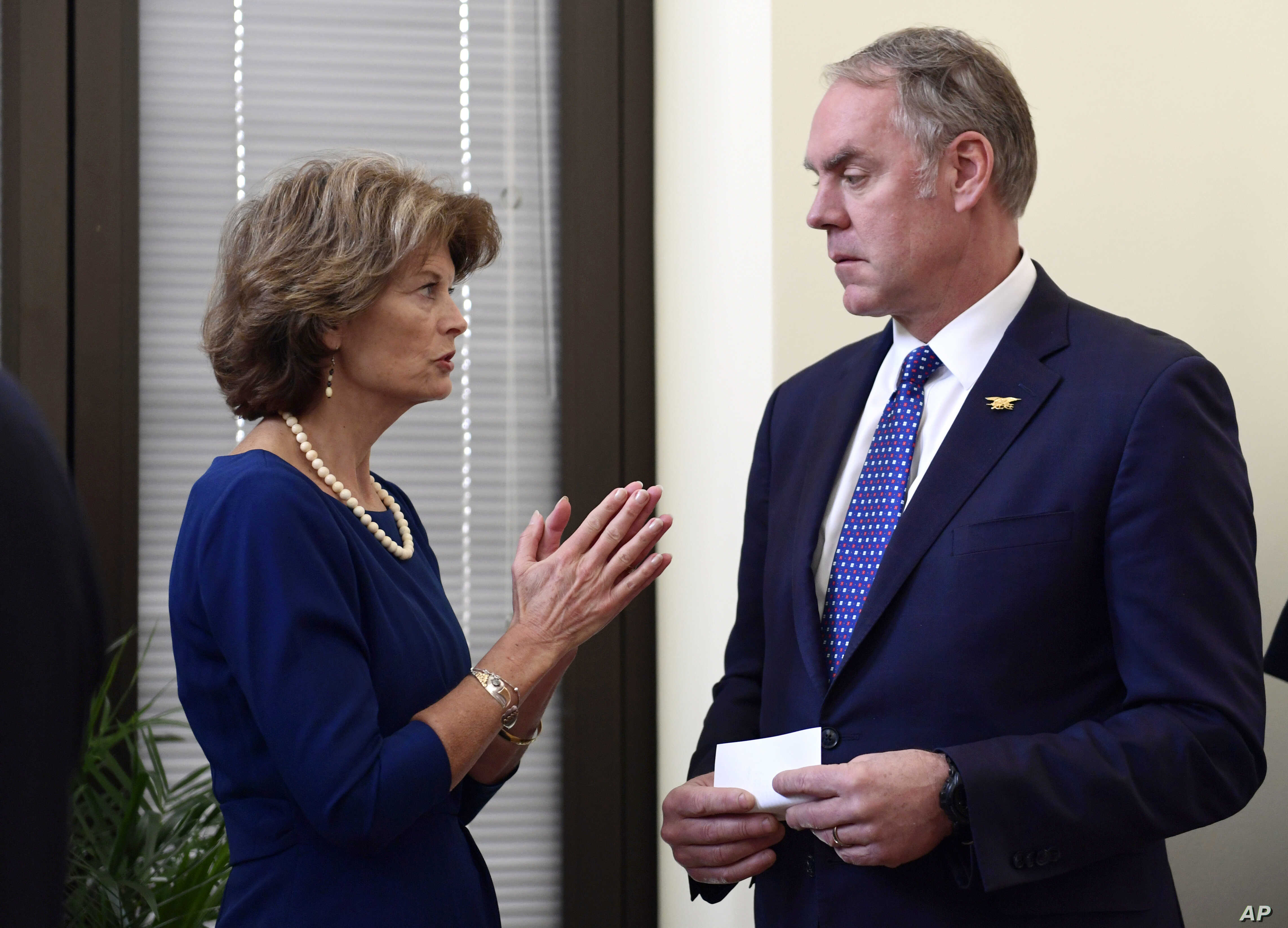 FILE - Sen. Lisa Murkowski, R-Alaska, talks with Interior Secretary Ryan Zinke in her office on Capitol Hill in Washington. Alaska's pro-development congressional delegation is asking the Trump administration to back off from offering nearly all land...