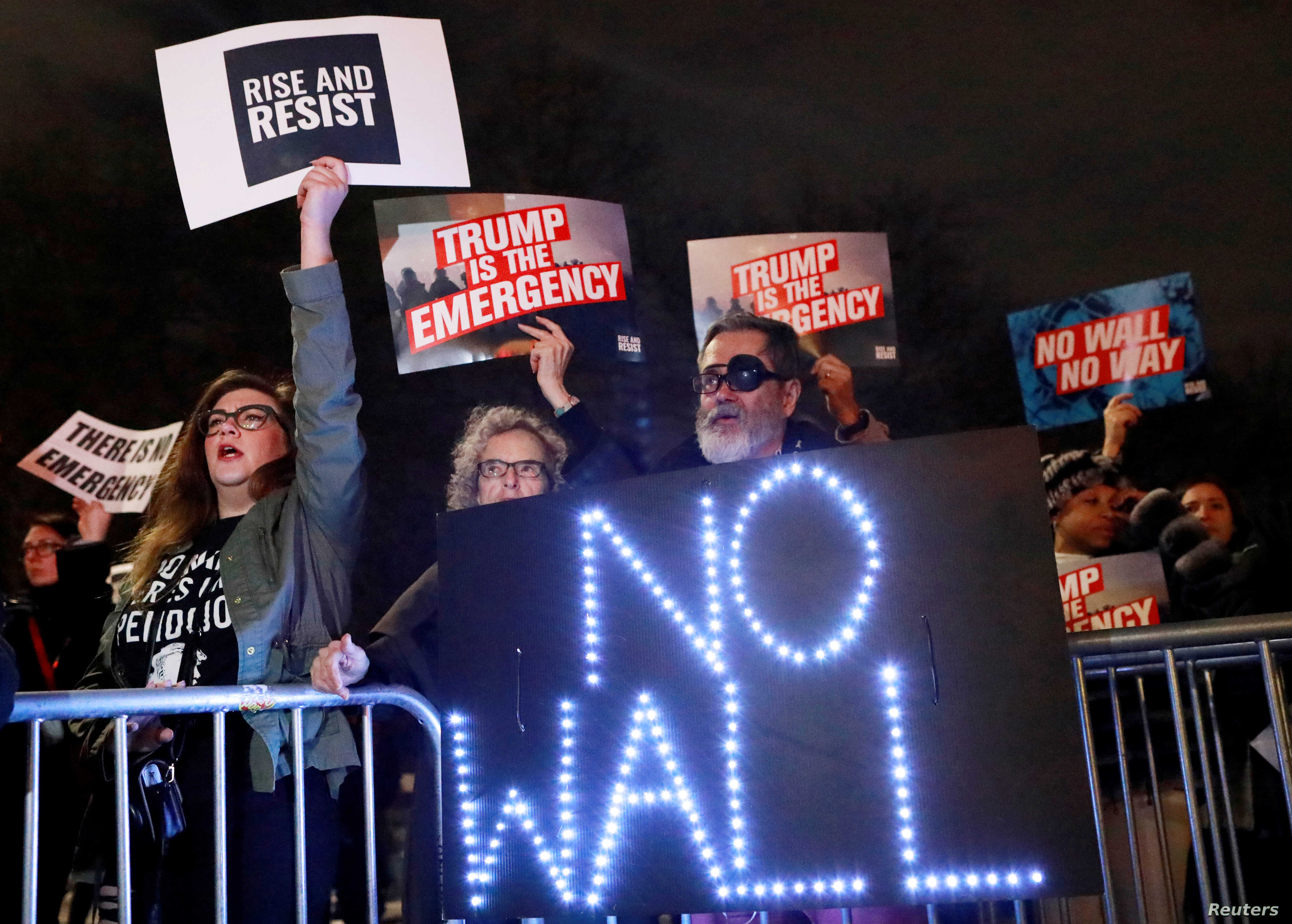 FILE - People gather during a protest against U.S. President Donald Trump's declaration of a national emergency to build a border wall, outside Trump International Hotel & Tower in Manhattan, New York.