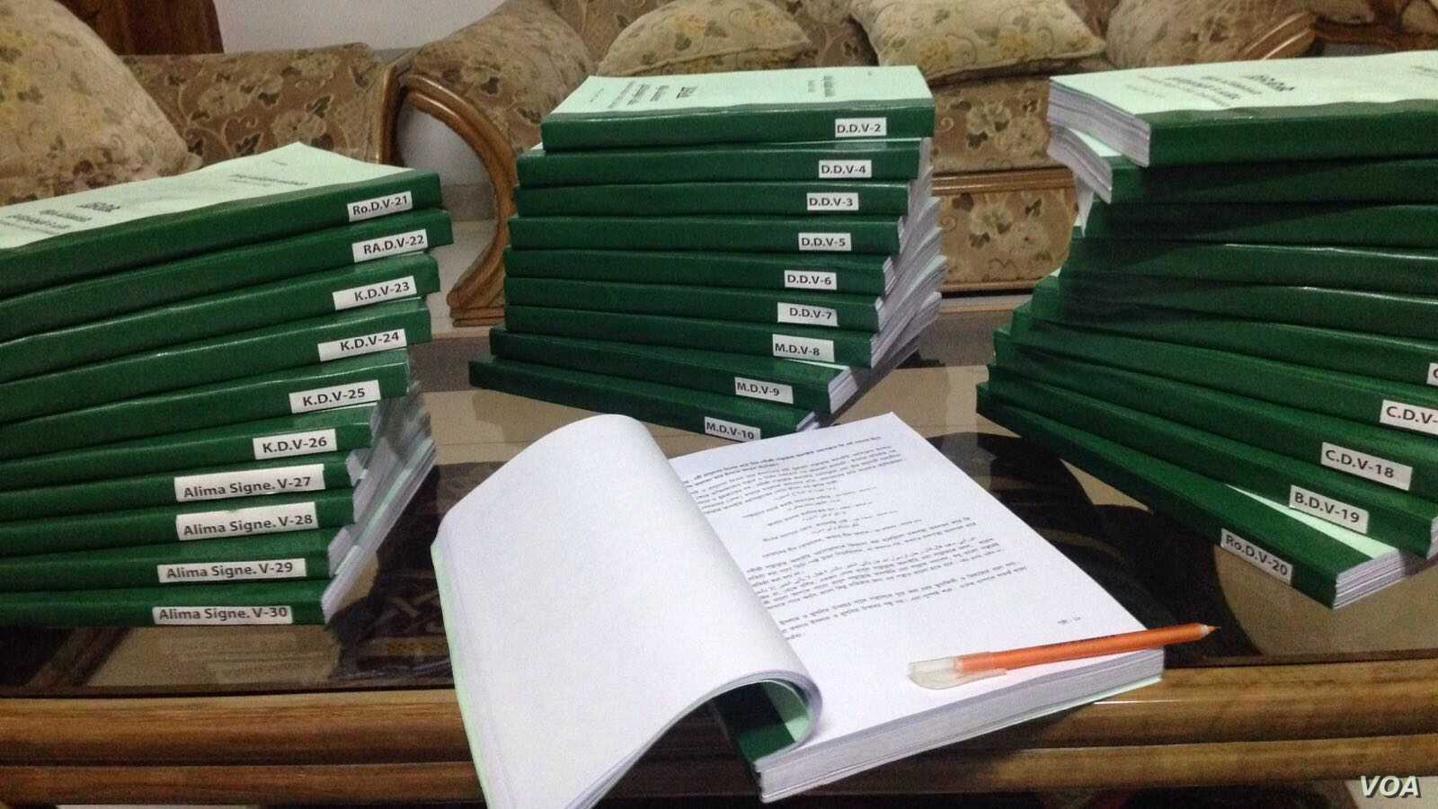 The paperwork of the fatwa on terrorism carried in 30 volumes. (J. Samnoon for VOA)