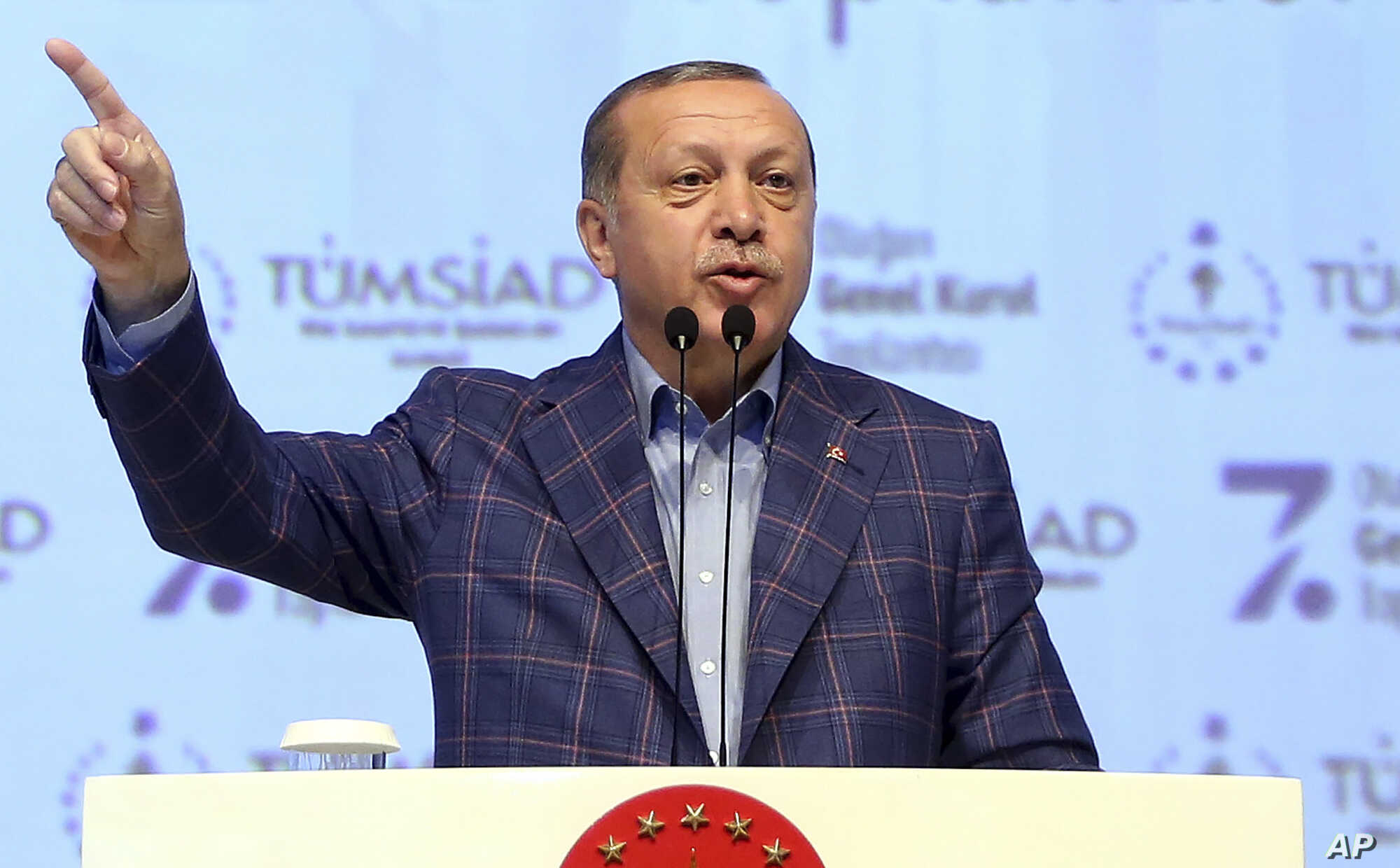 Turkey's President Recep Tayyip Erdogan, gestures as he delivers a speech at a conference in Istanbul, April 29, 2017.