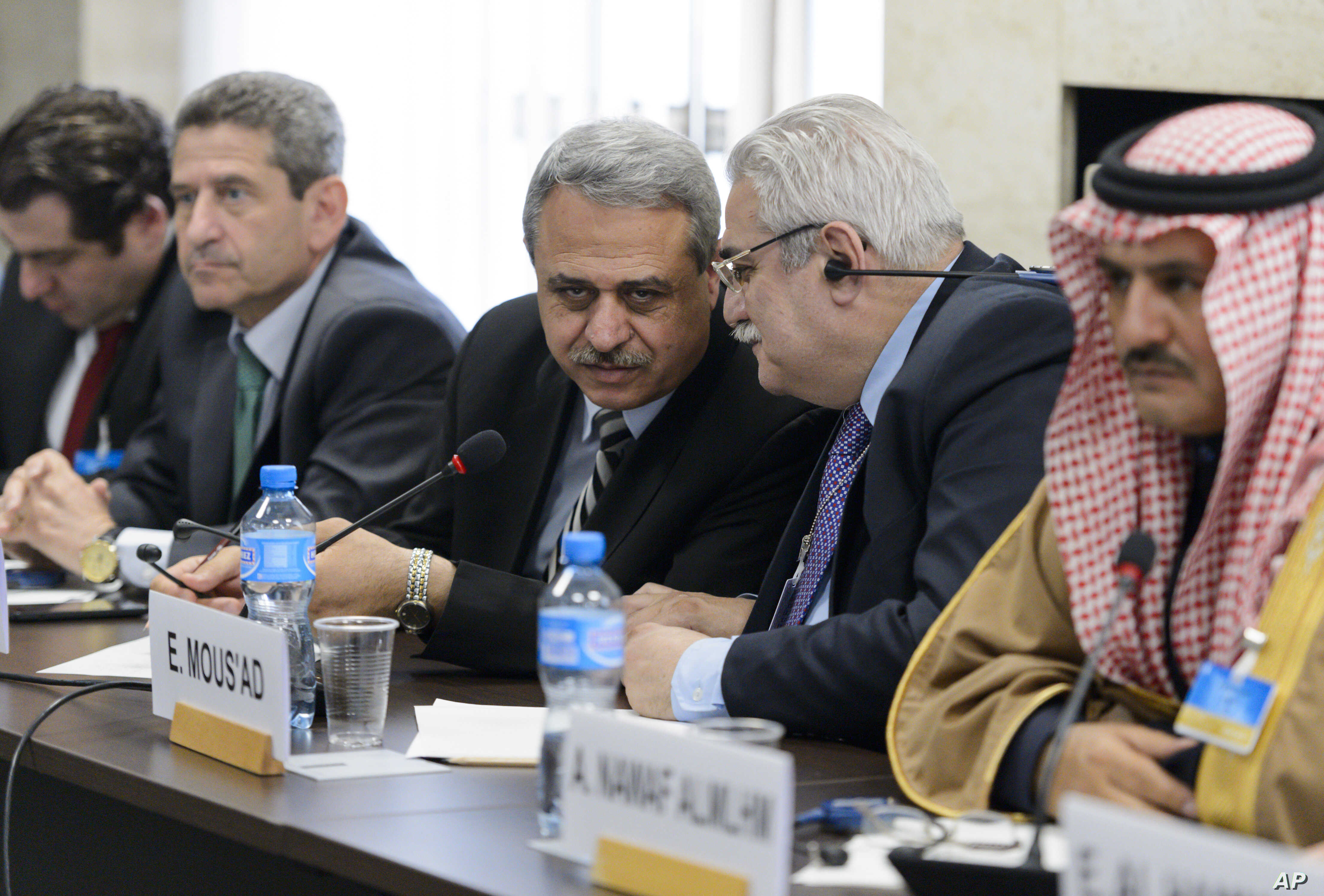 Member of the Syrian interior opposition Mahmoud Marai, third right, listens to Elian Mous'ad, second right, during a meeting with the UN Syria Envoy during Syria peace talks at the United Nations Office in Geneva, Switzerland, April 22, 2016.