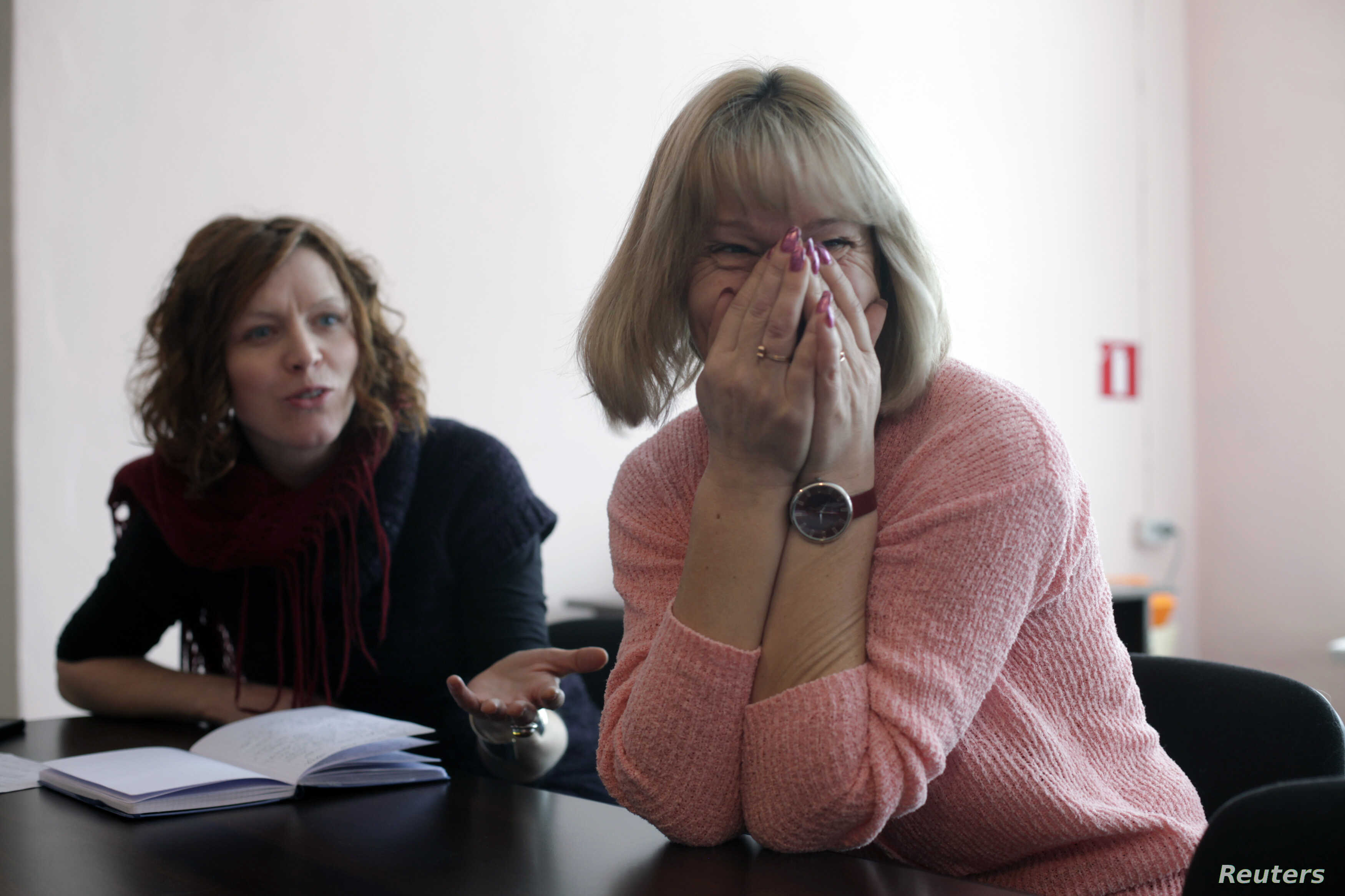 Biruta Kadakovska (R) reacts as she talks with migration researcher social anthropologist Dace Dzenovska during an interview in Malnava near Karsava about 300 km (186 miles) east from capital Riga, Latvia, Feb. 29, 2012.