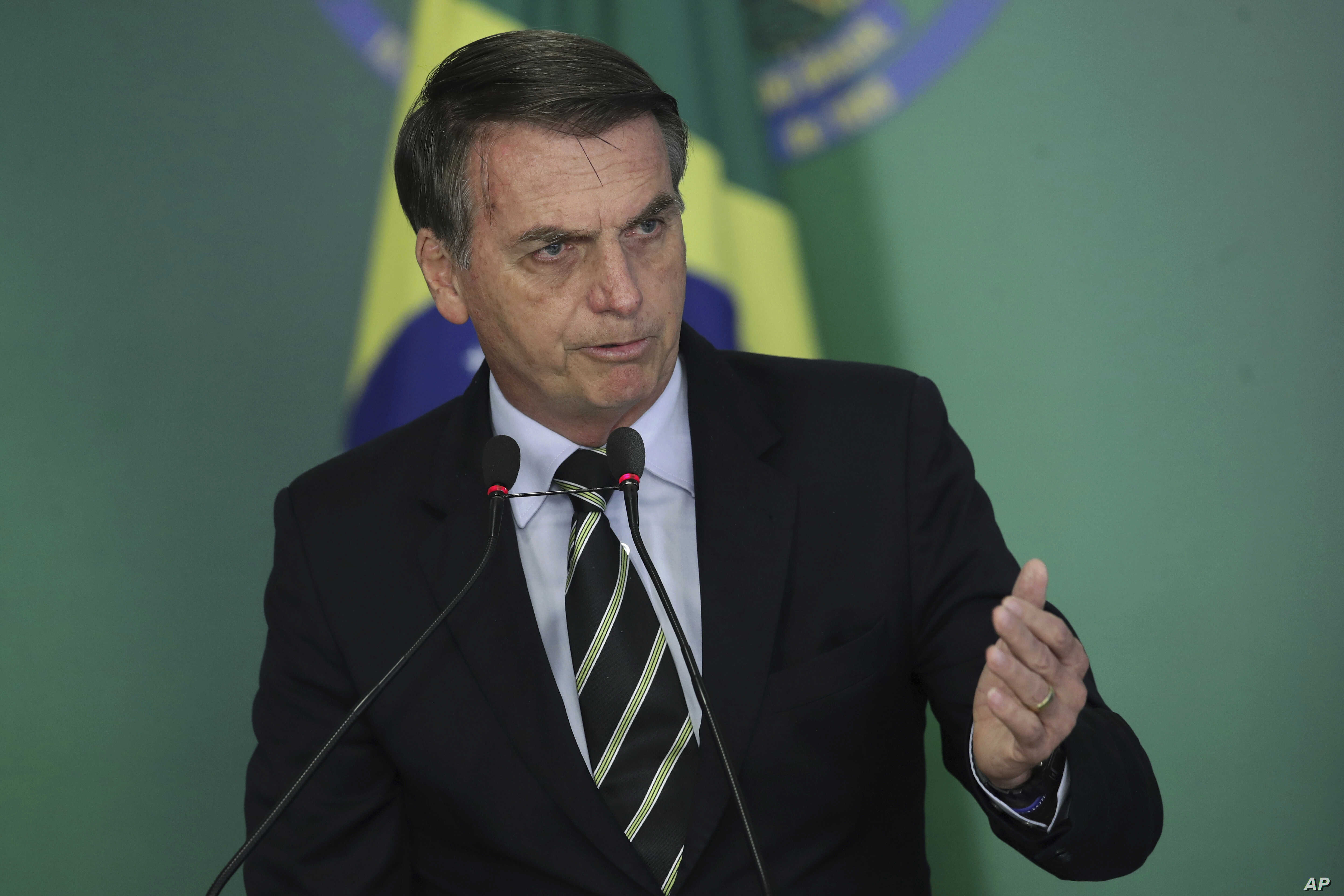 Brazil's President Jair Bolsonaro speaks during a ceremony where he signed a decree loosening restrictions on owning a firearm at Planalto presidential palace in Brasilia, Brazil, Tuesday, Jan. 15, 2019.