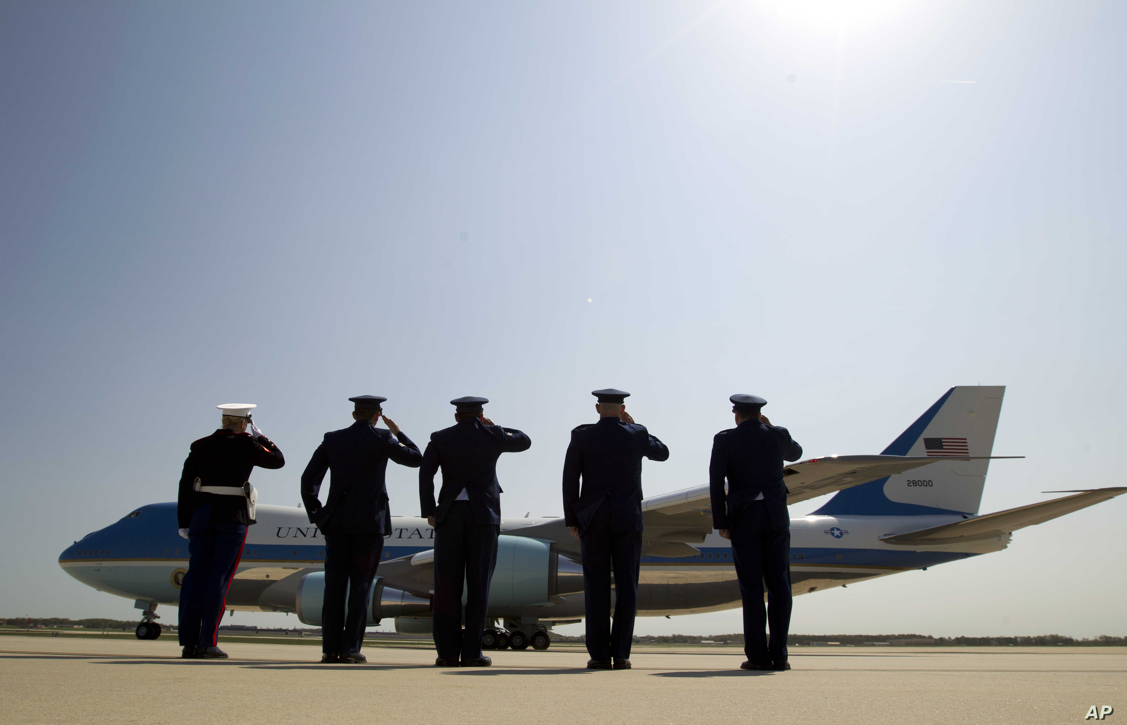 Military personnel salutes as Air Force One, with President Barack Obama aboard, departs from Andrews Air Force Base in Md., Wednesday, April 22, 2015. Obama is celebrating Earth Day with a visit to the Everglades to talk about how global warming thr...